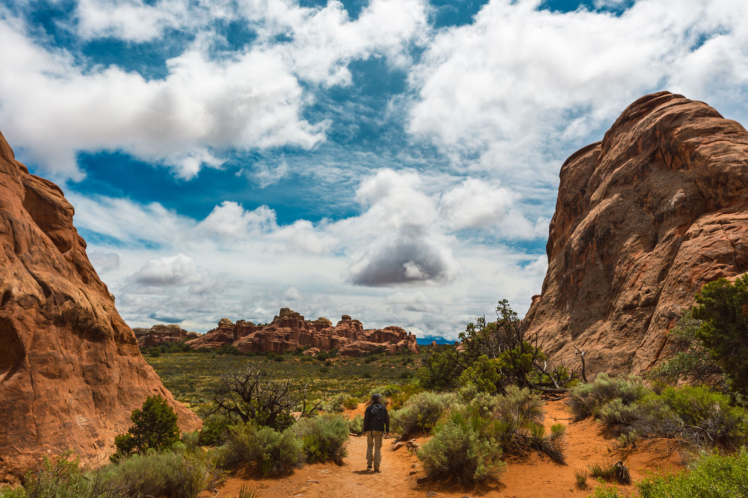 A visitor takes a walk through Arches National Park, Utah.