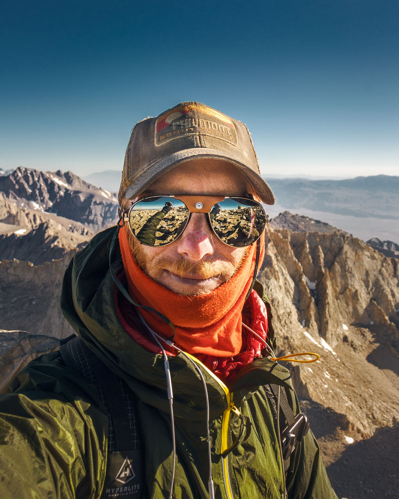 Wearing every single layer on top of Mount Whitney, California.