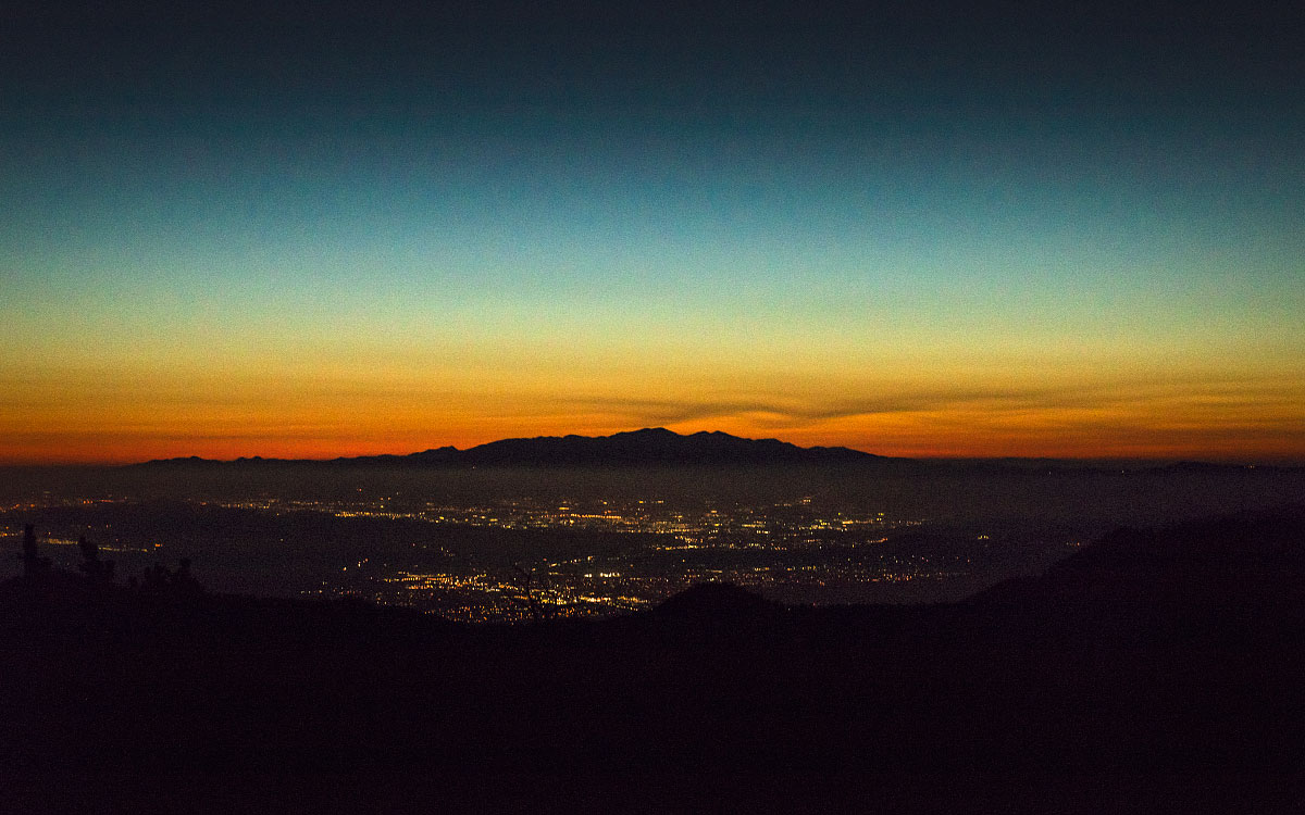 The city of Palm Springs, California lit up at dusk.