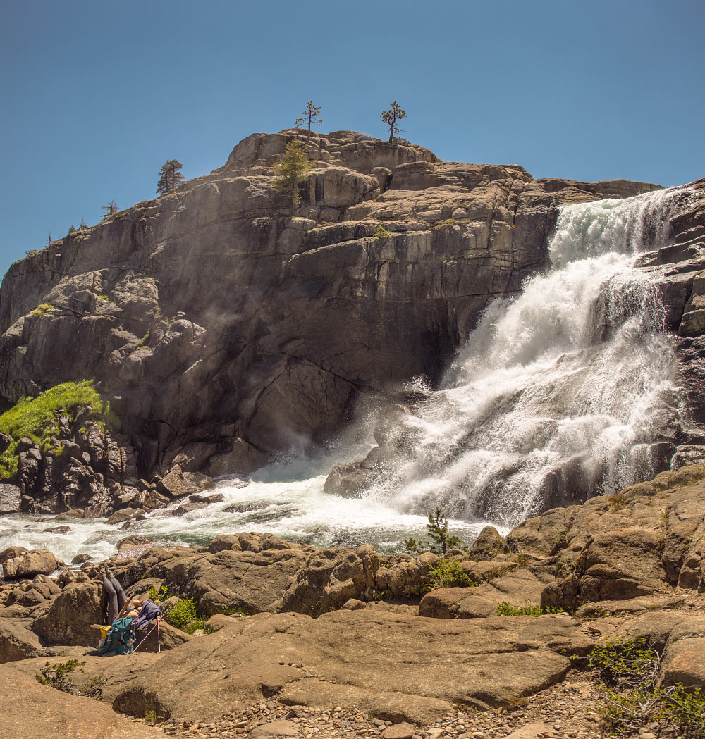 A hiker suns herself beneath Tuolumne Falls.