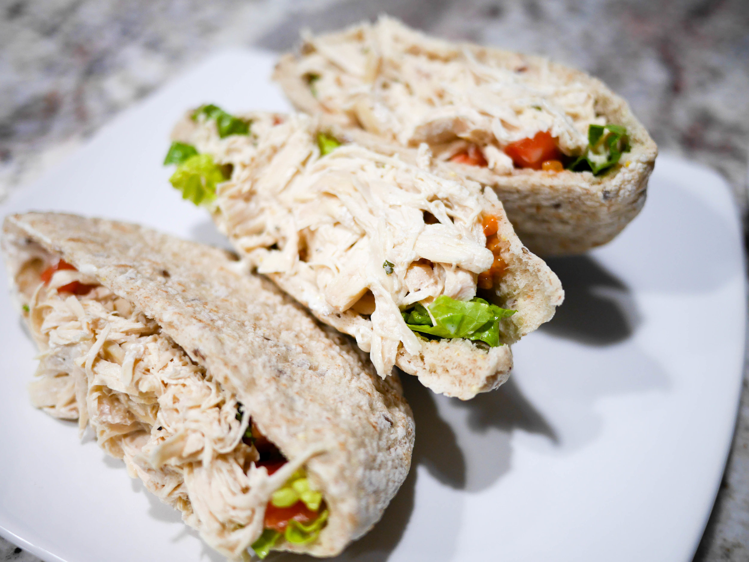 Chef in Training's slow cooker caesar chicken is perfect for stuffing whole grain pitas or spinach-tortillas as well as for topping slider buns.