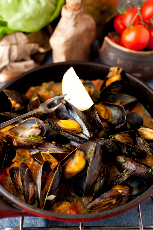 Simple and decadent, these steamed mussels in a white wine sauce with onions and tomatoes are perfect for your next special occasion. Recipe and image from  Cooking Menagery .