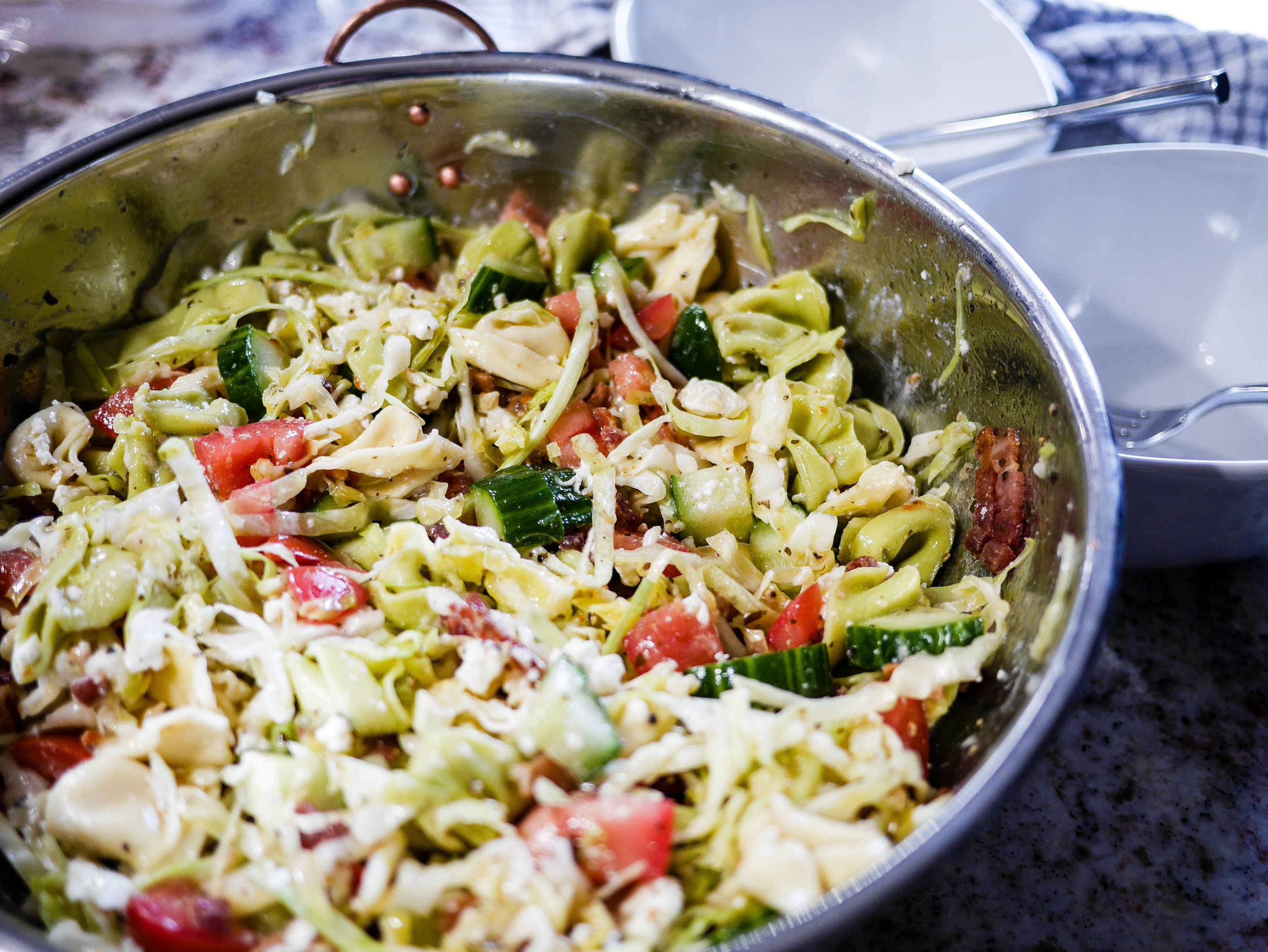 """Is there anything better than a recipe with the directions, """"mix everything together...chill...serve""""?! This tortellini pasta salad is so easy, and a delicious make-ahead main or side."""