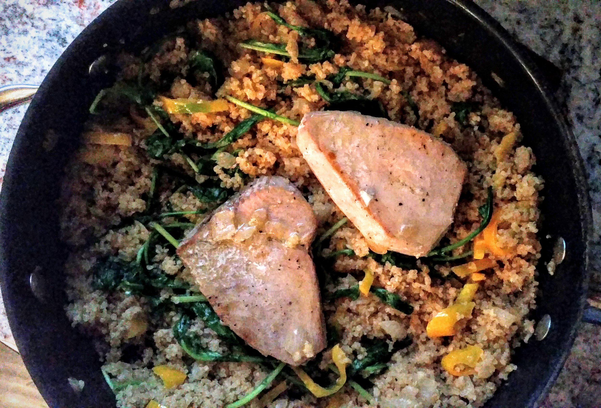 Colorful and veggie filled quinoa makes the perfect bed for Yellowfin Tuna steaks.