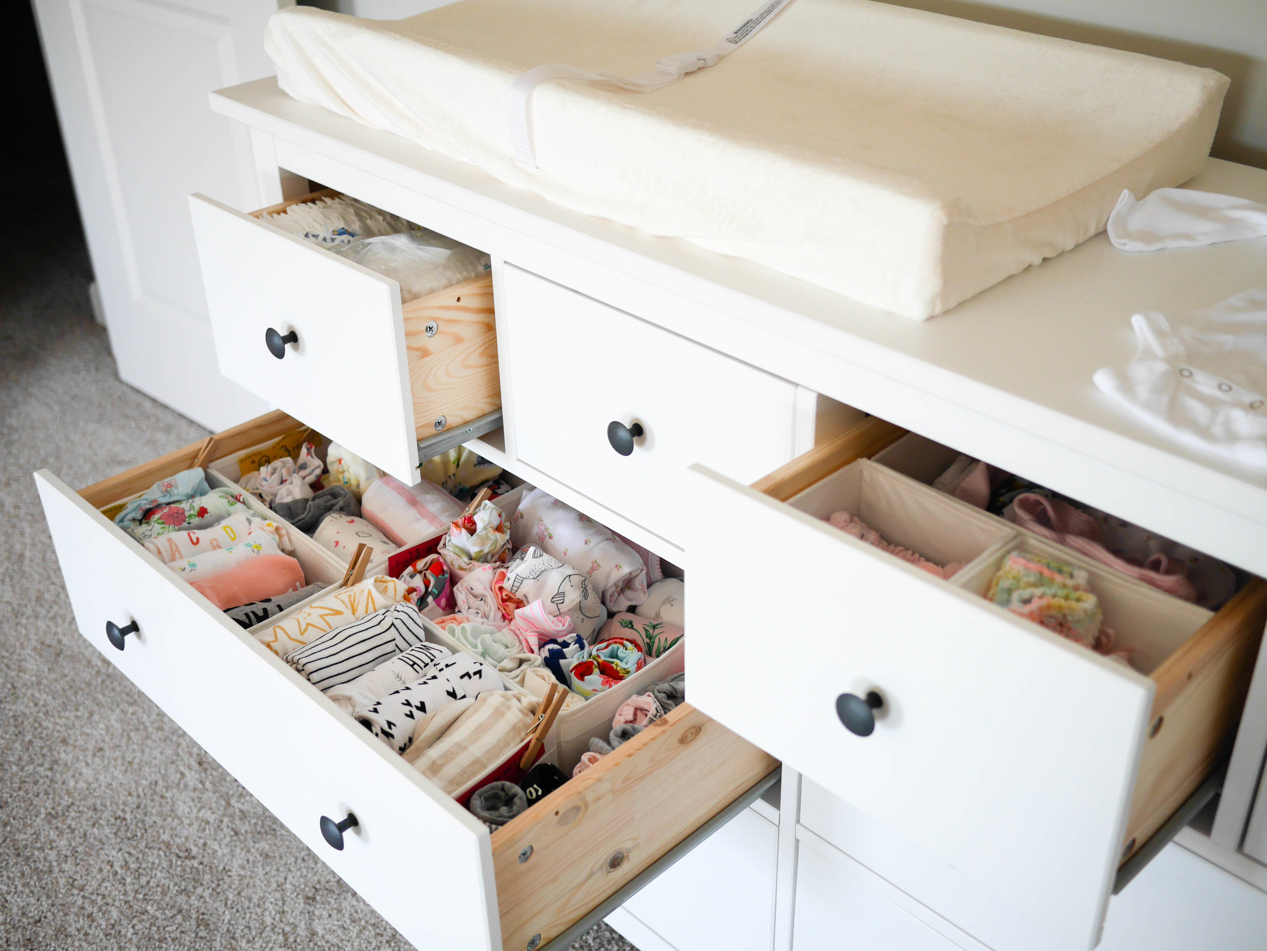 A dresser provides all the storage and a spacious changing space that you could dream of in a nursery.
