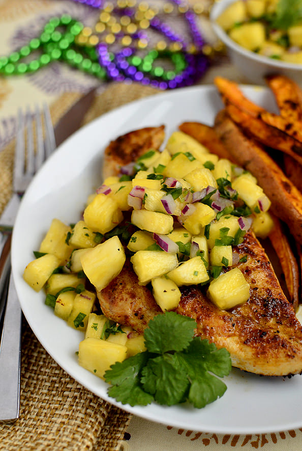 Limit food waste by keeping ingredients consistent throughout the week! This easy and delicious Cajun Chicken with Mardi Gras Salsa is the perfect way to use up some of the ingredients from earlier in the week! Photo credit & permissions from Kristin at  Iowa Girl Eats .