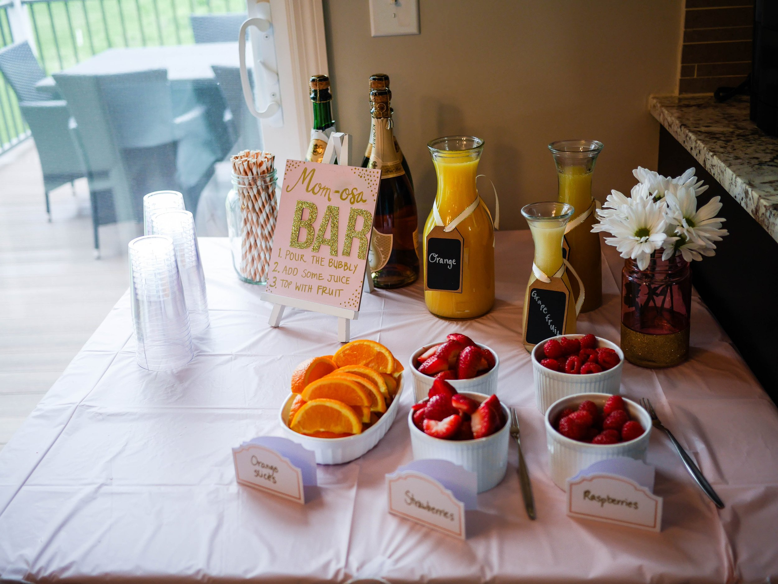 Include alcoholic and non-alcoholic bubbly options, fresh fruit and a variety of juices to make the perfect mom-osa bar.