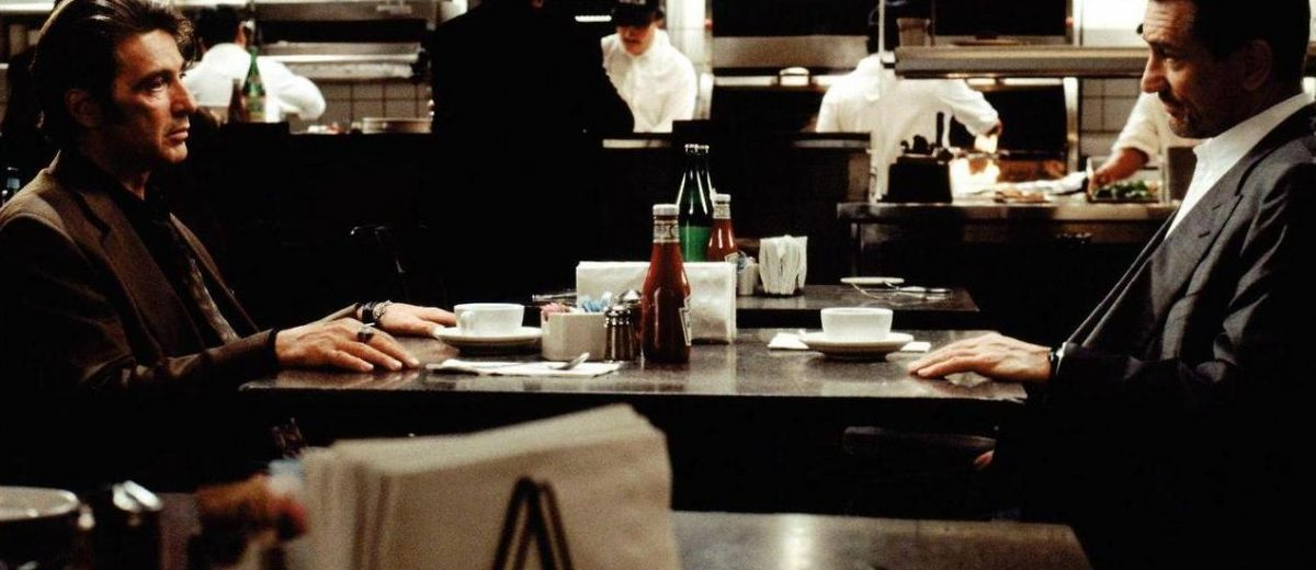 In Heat (1995),  this iconic scene works as a successful mid-point due to its dialogue and editing pacing.
