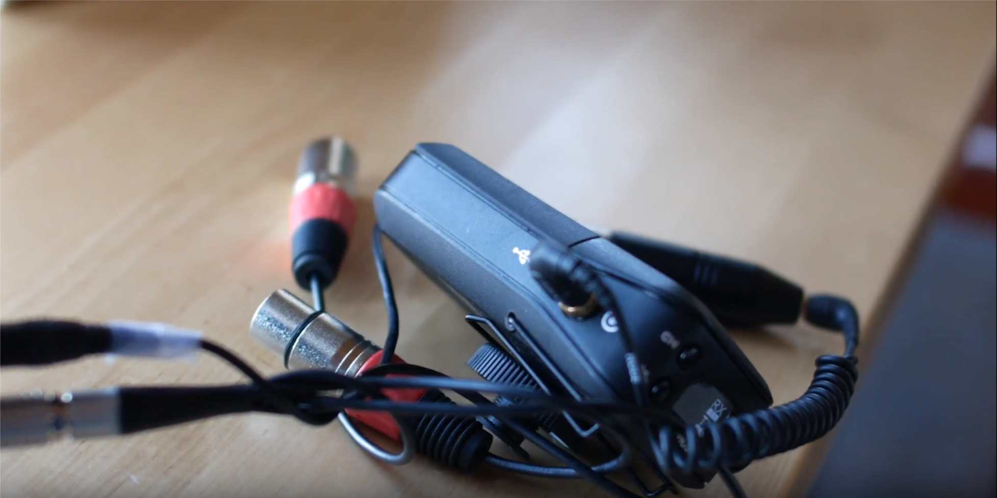 The RodeLink system can plug right into the micro-XLR adapter of the Atomos Shogun Flame, but you will need a  3.5mm to male_XLR adapter.