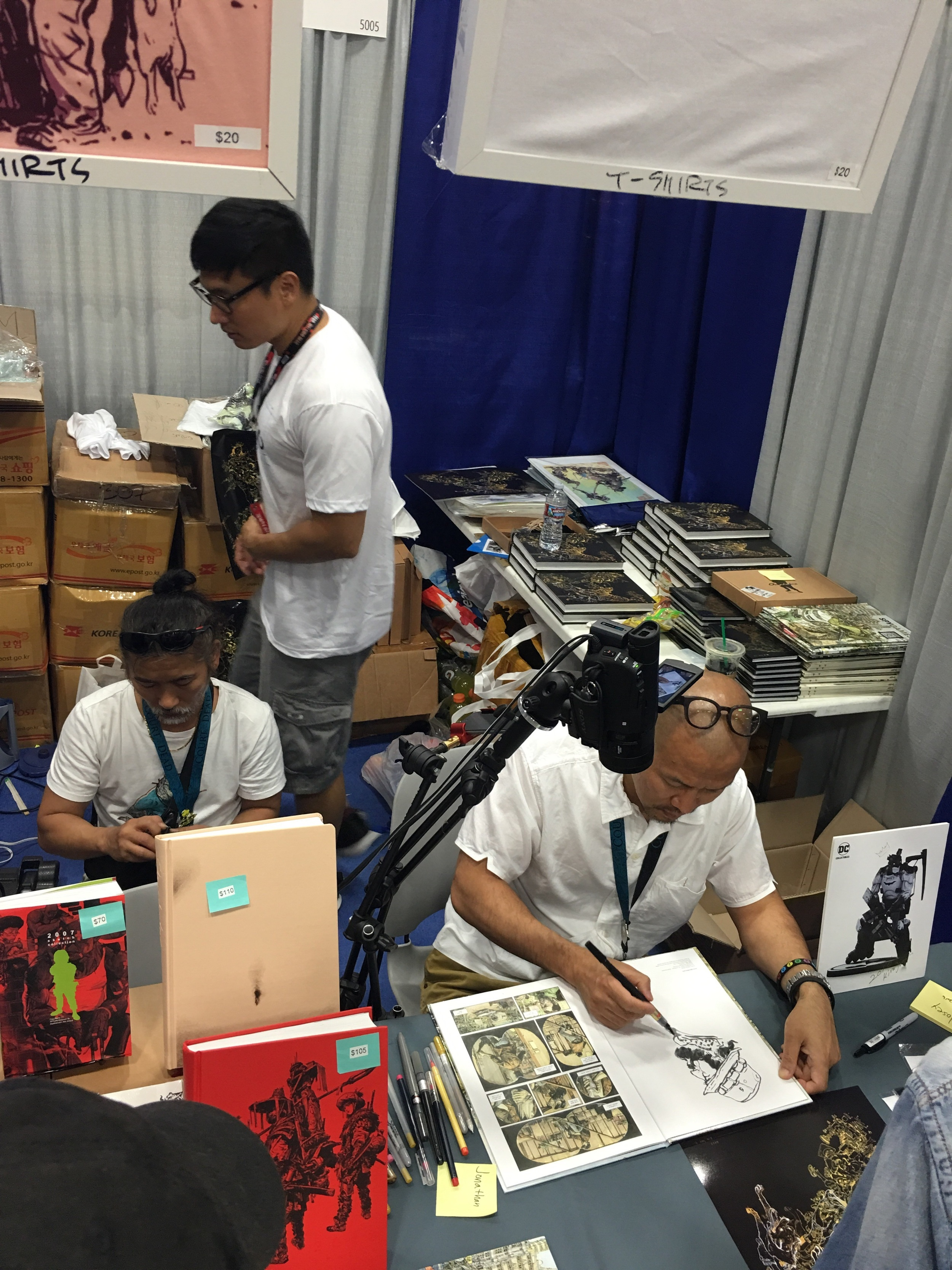 Kim Jung Gi  Drawing a sketch in one of his art books at Booth