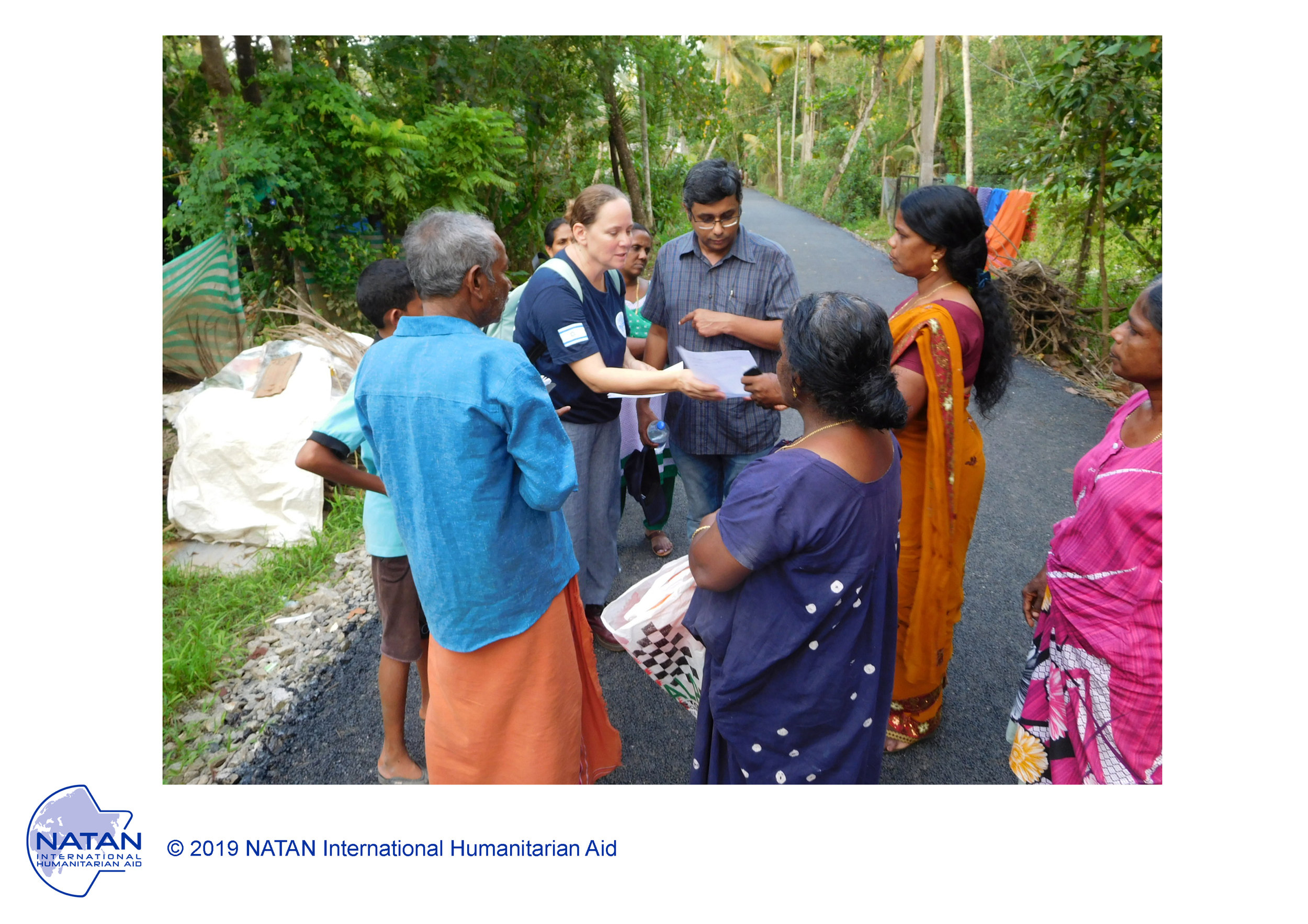 india 2018 - members of natan assessment team speak with survivors of monsoon floods in kerala region,