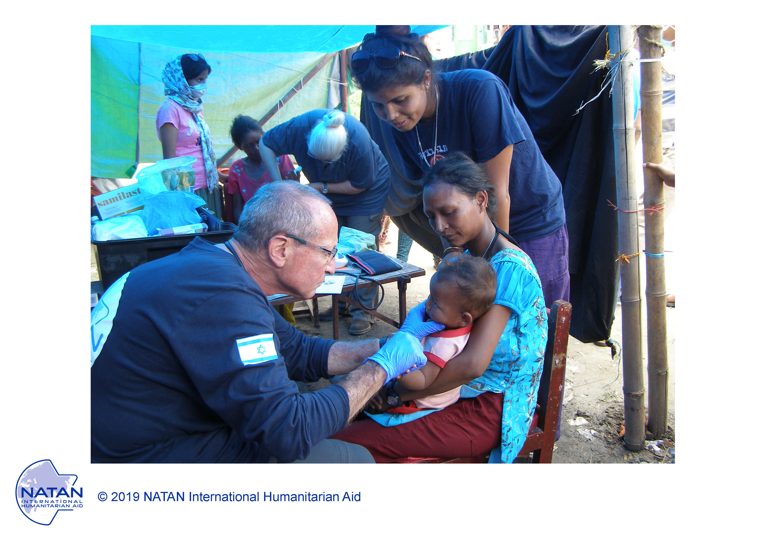 nepal 2015 - natan medical team treating earthquake survivors. seen here, natan md, social worker, and nurse working together as one multidisciplinary team.