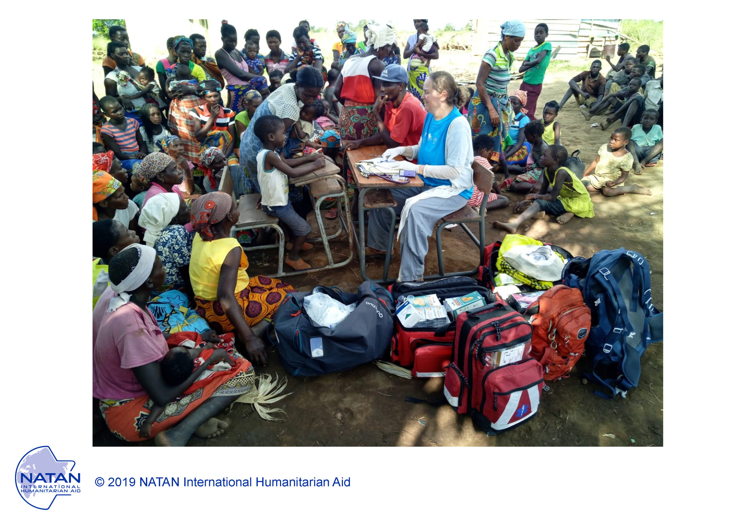 mozambique 2019 - natan md treating patients at outdoor field clinic near beira mozambique following cyclone idai