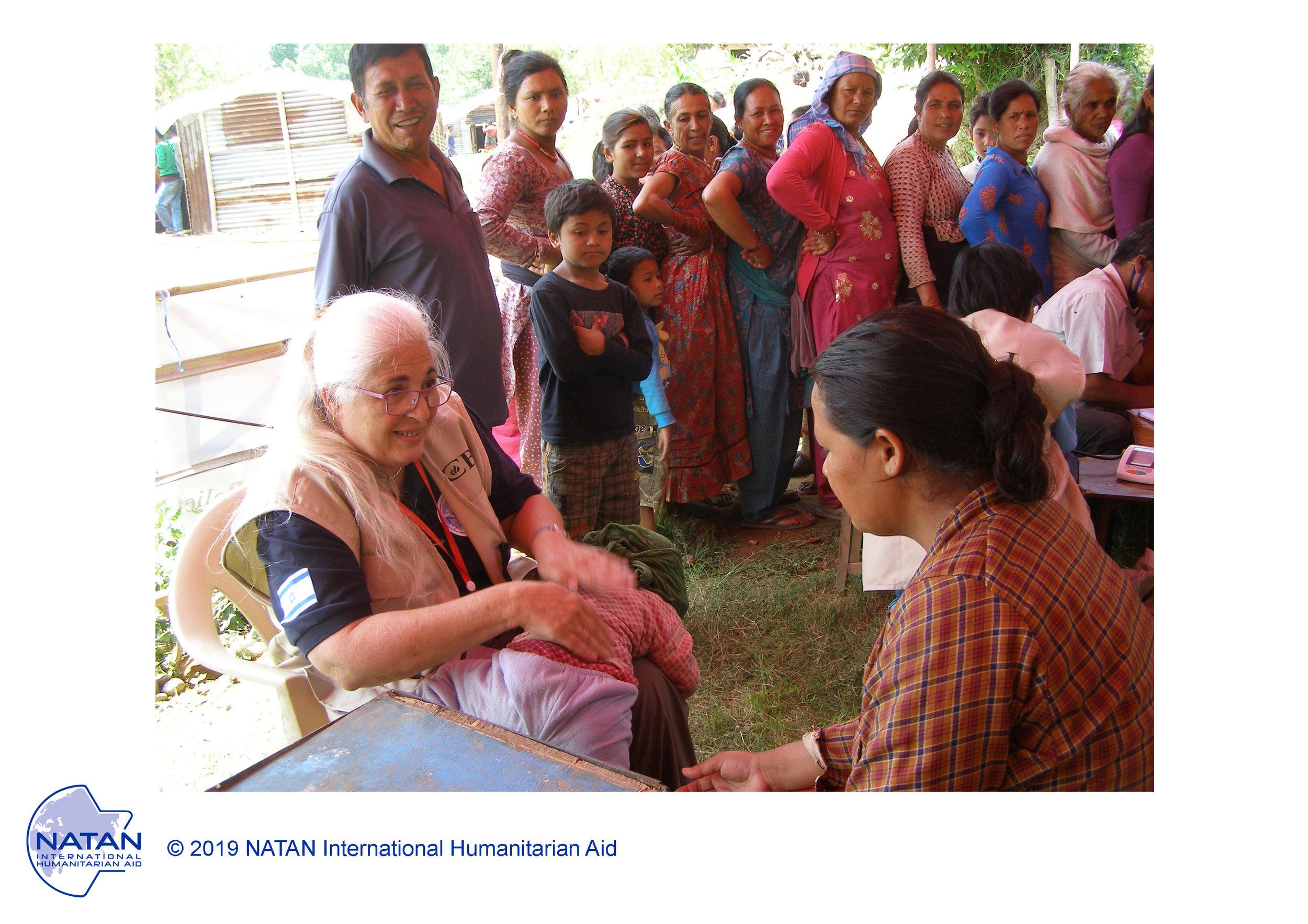 nepal 2015 - natan nurse performing assessments of earthquake survivors in nepal