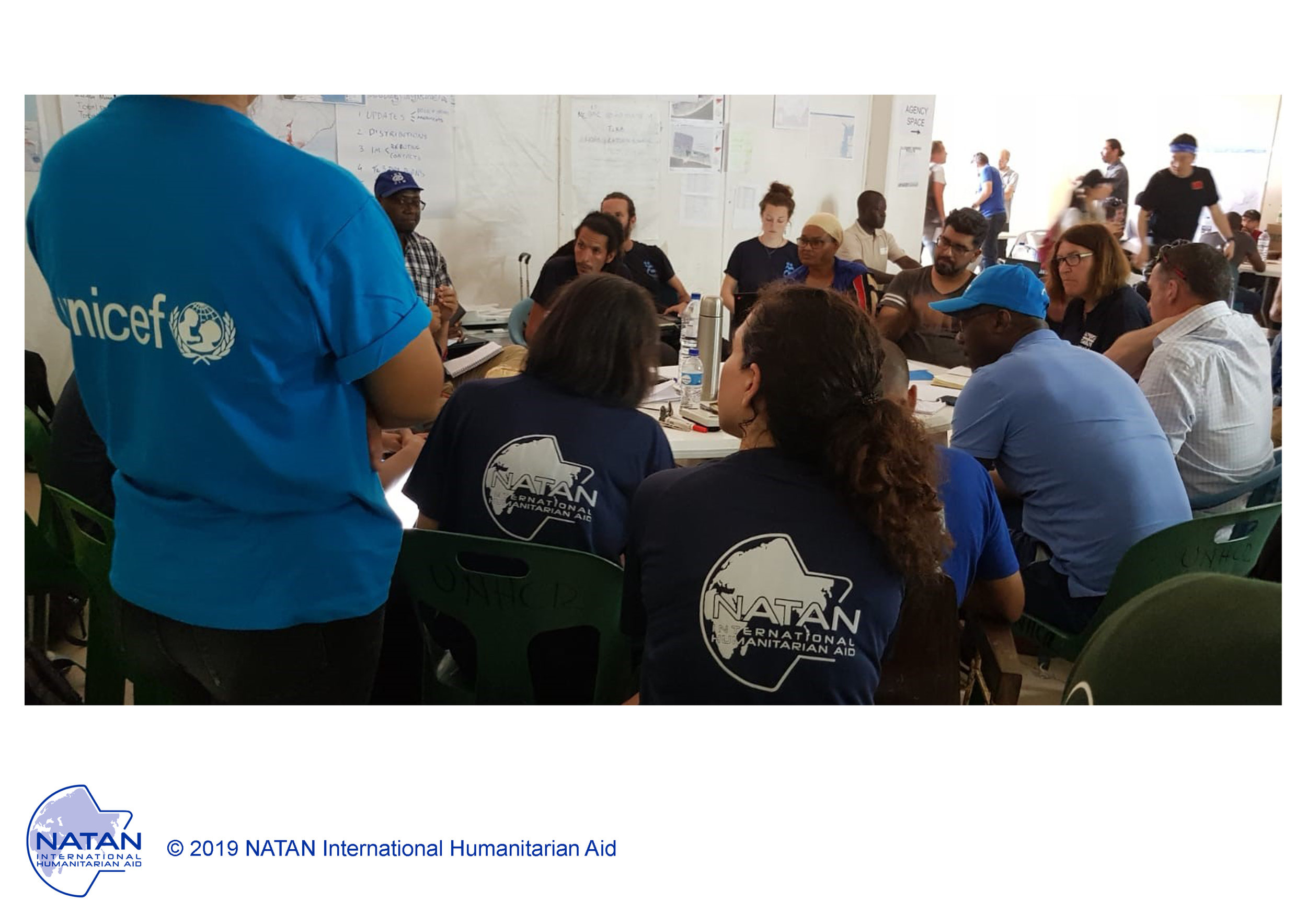 mozambique 2019 - collaboration: NATAN team members participate in daily briefing for all aid organizations in the emergency operations center set up by the un following cyclone idai