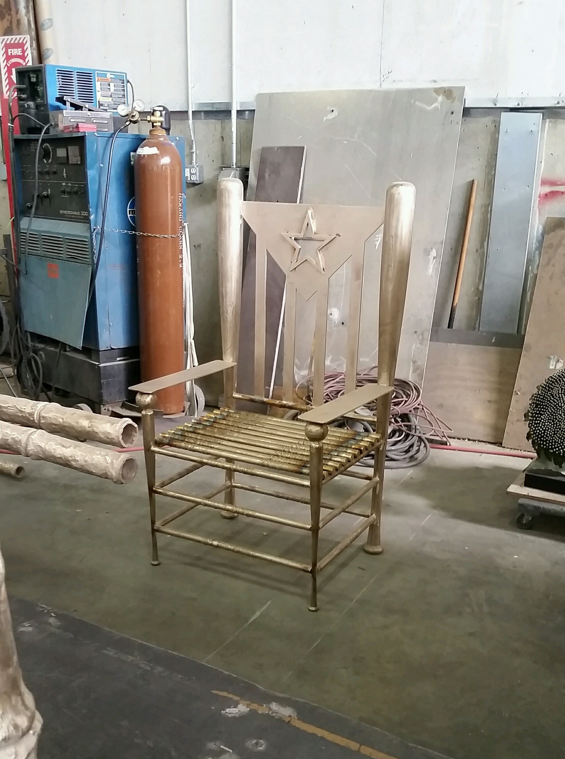 "The oversized ""Abuelo"" chair for Para Roberto. Made from casted baseball and stickball bats. ""pinky""balls included."