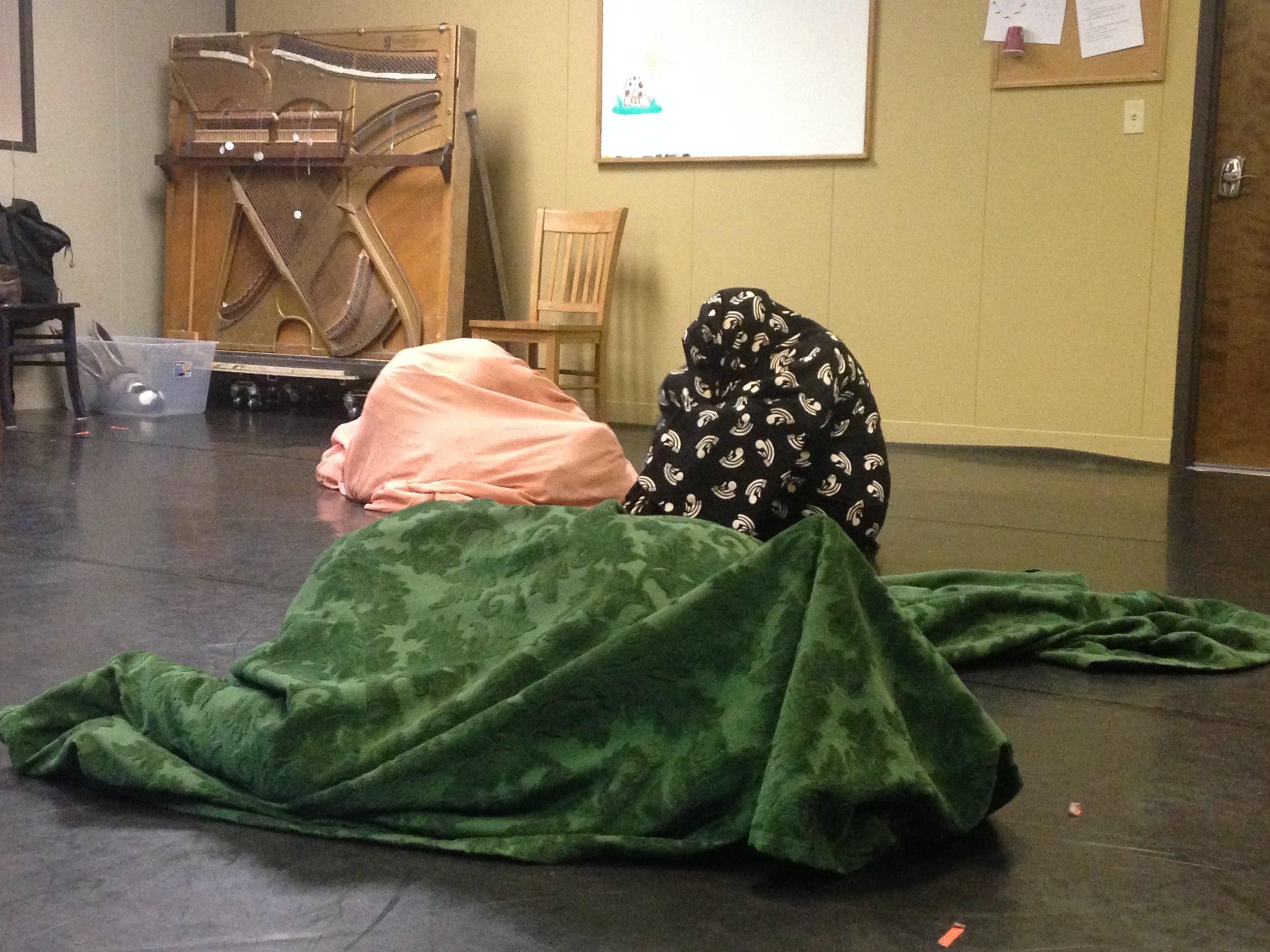 Three lumps in rehearsal.