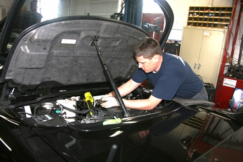 Ted performing a valve adjustment on an Acura NSX