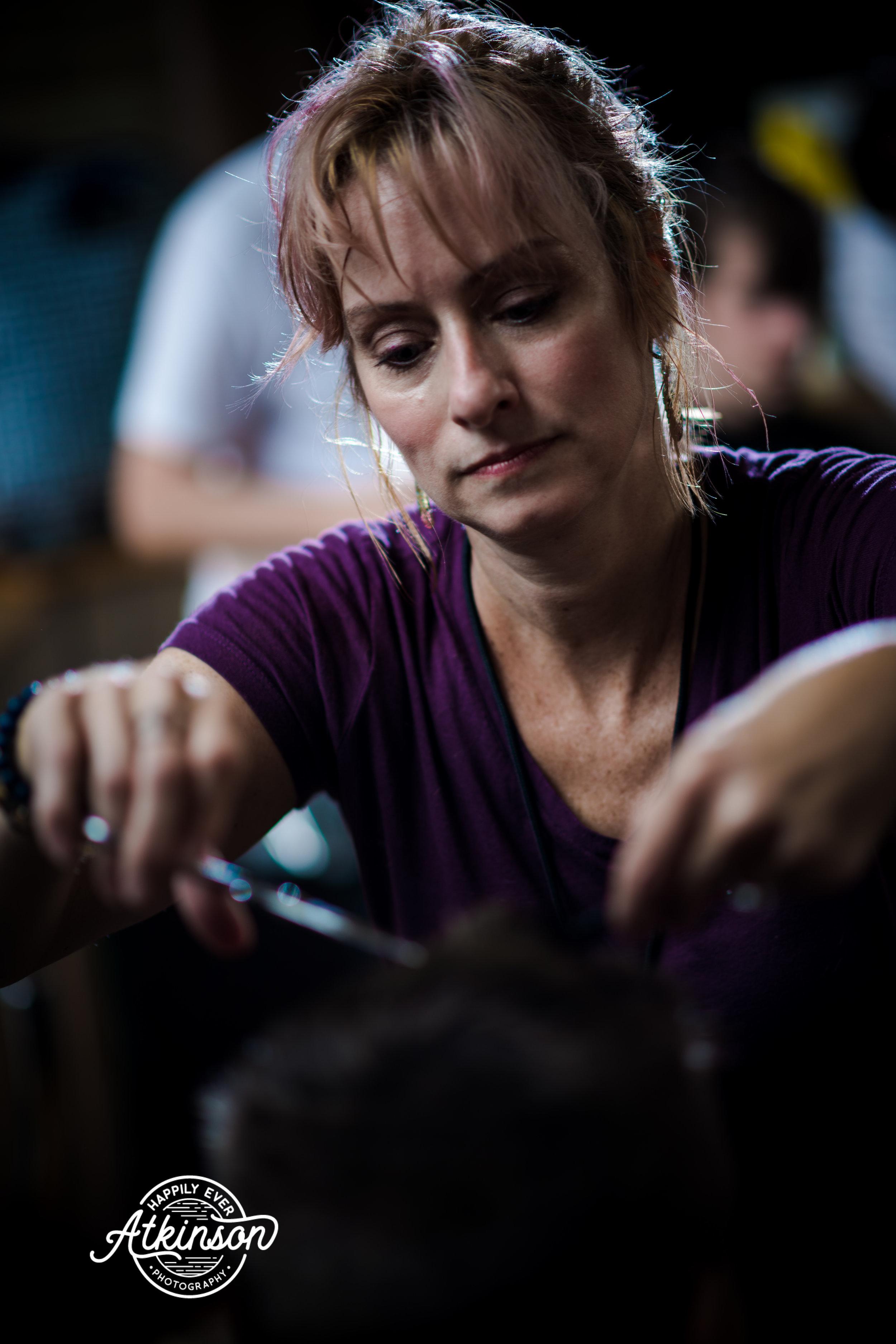 Woman gives a haircut