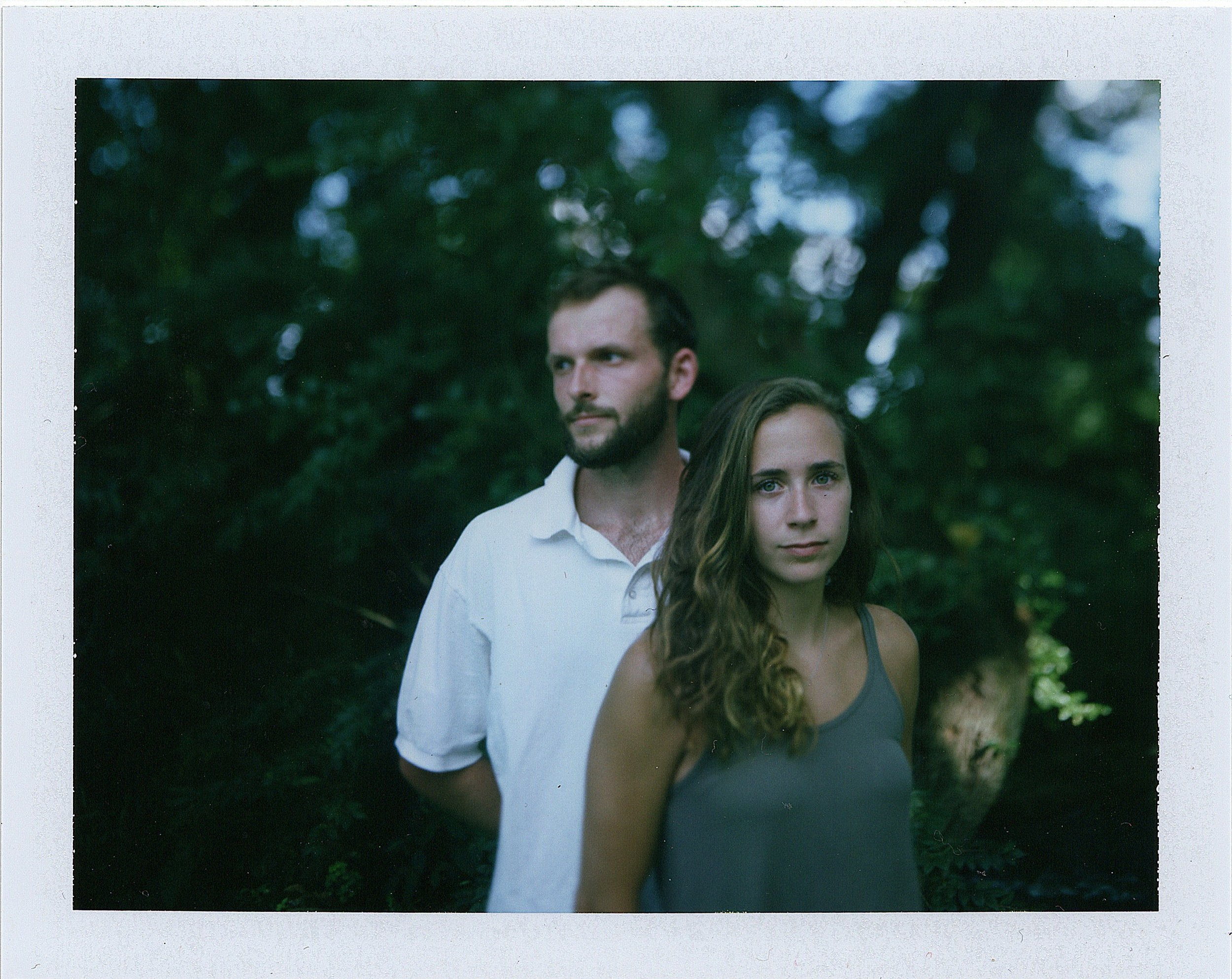 This is a photo I took of these two at their summer party. Its shot on old Polaroid film with a 4x5 camera.