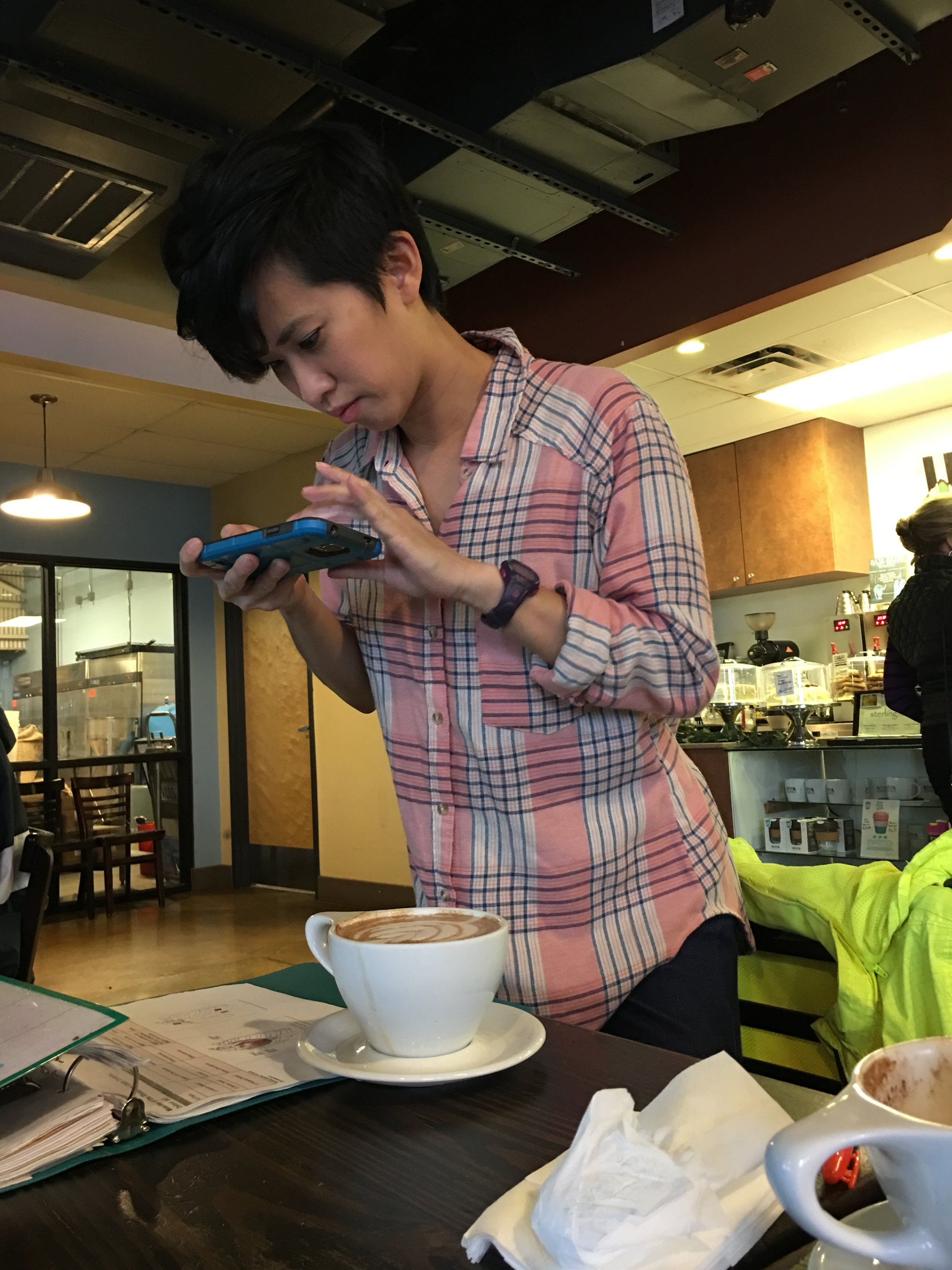 Jessica is capturing pictures of her hot Mocha.