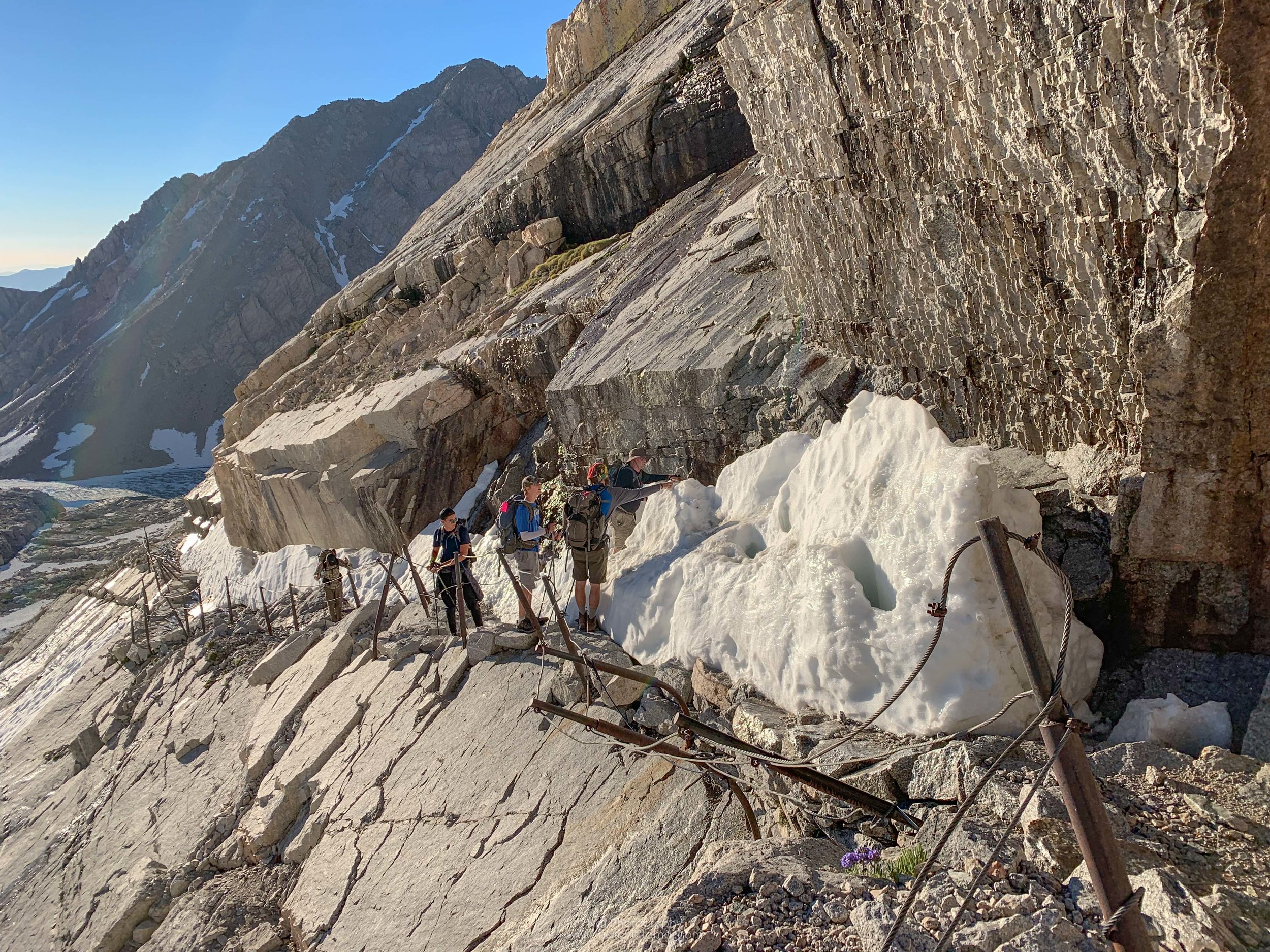 Hikers are figuring out the best way to cross this section.