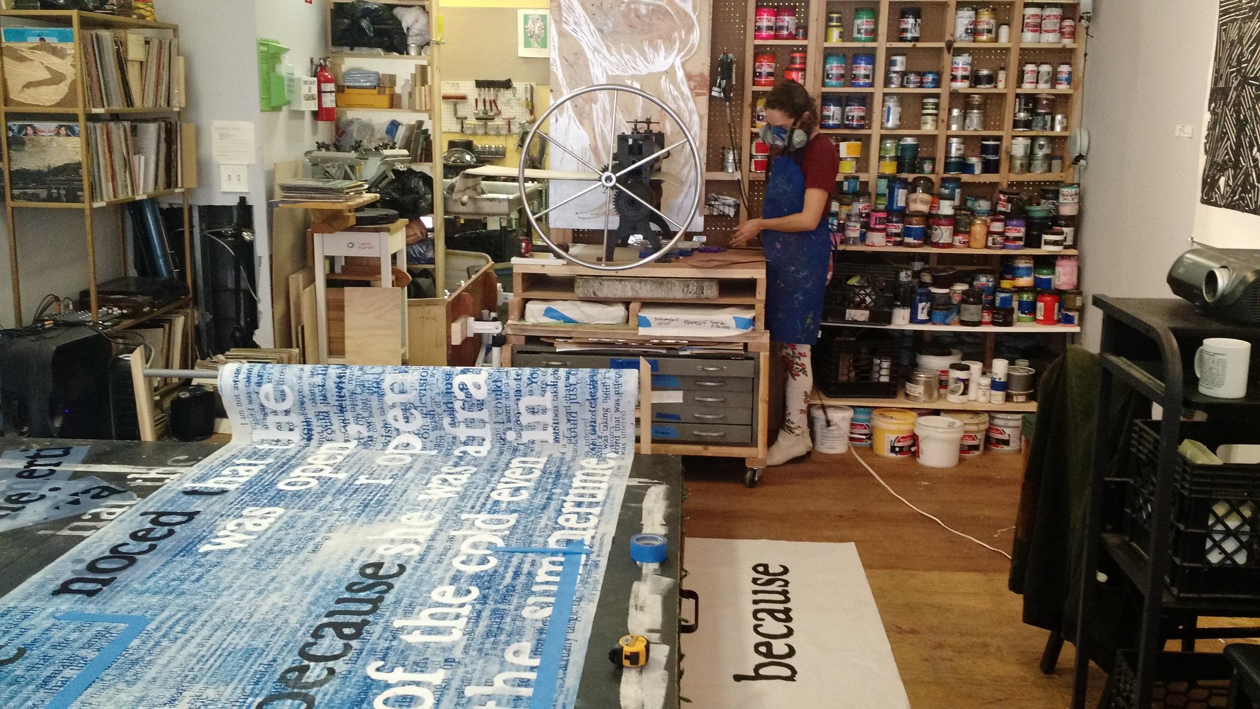 Members working inside Shoestring Press