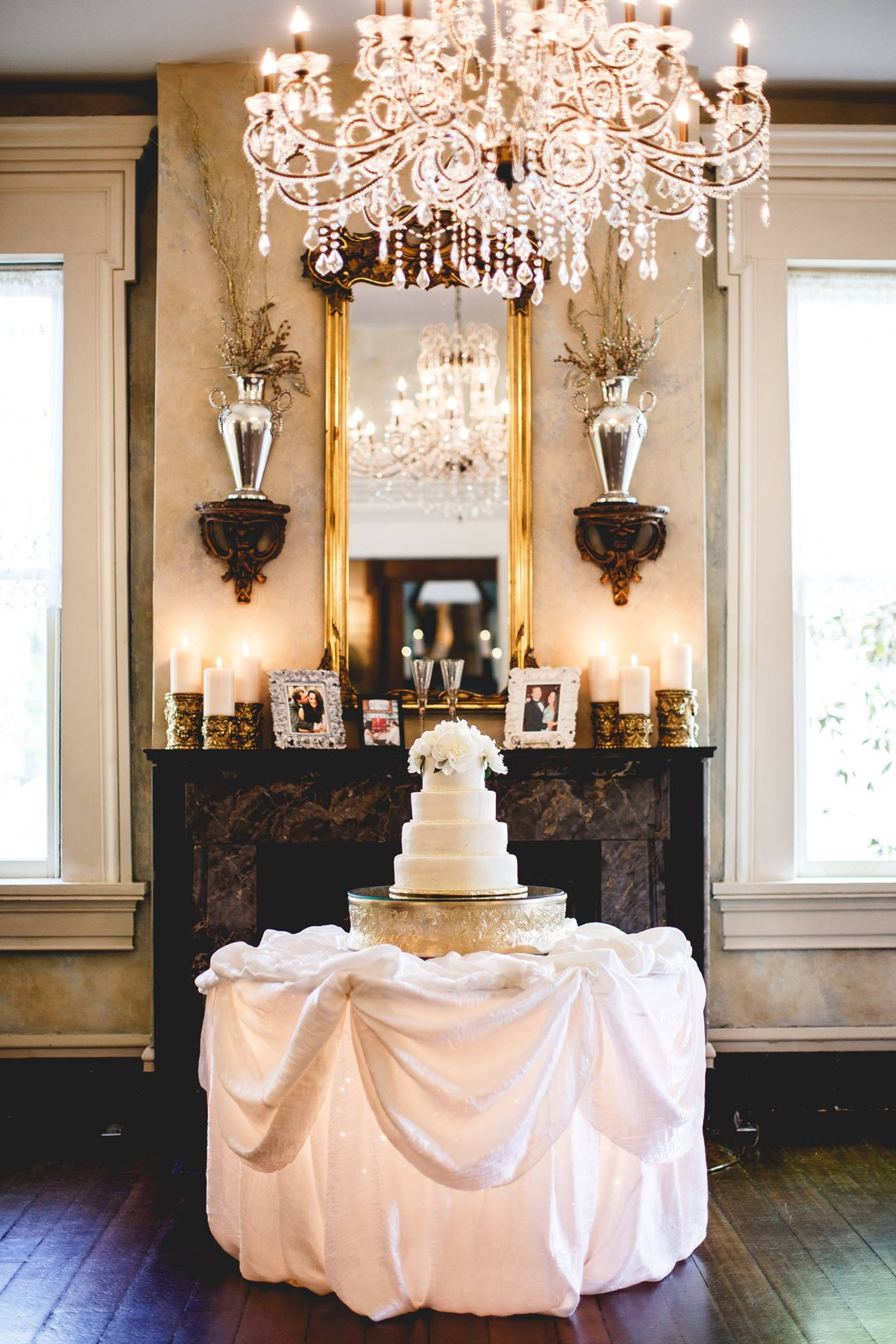 A white wedding cake is always classic and elegant. Add overflowing fresh white florals to dress up the top tier and to match the bridal bouquet.   Photo: Janelle Elise Photography