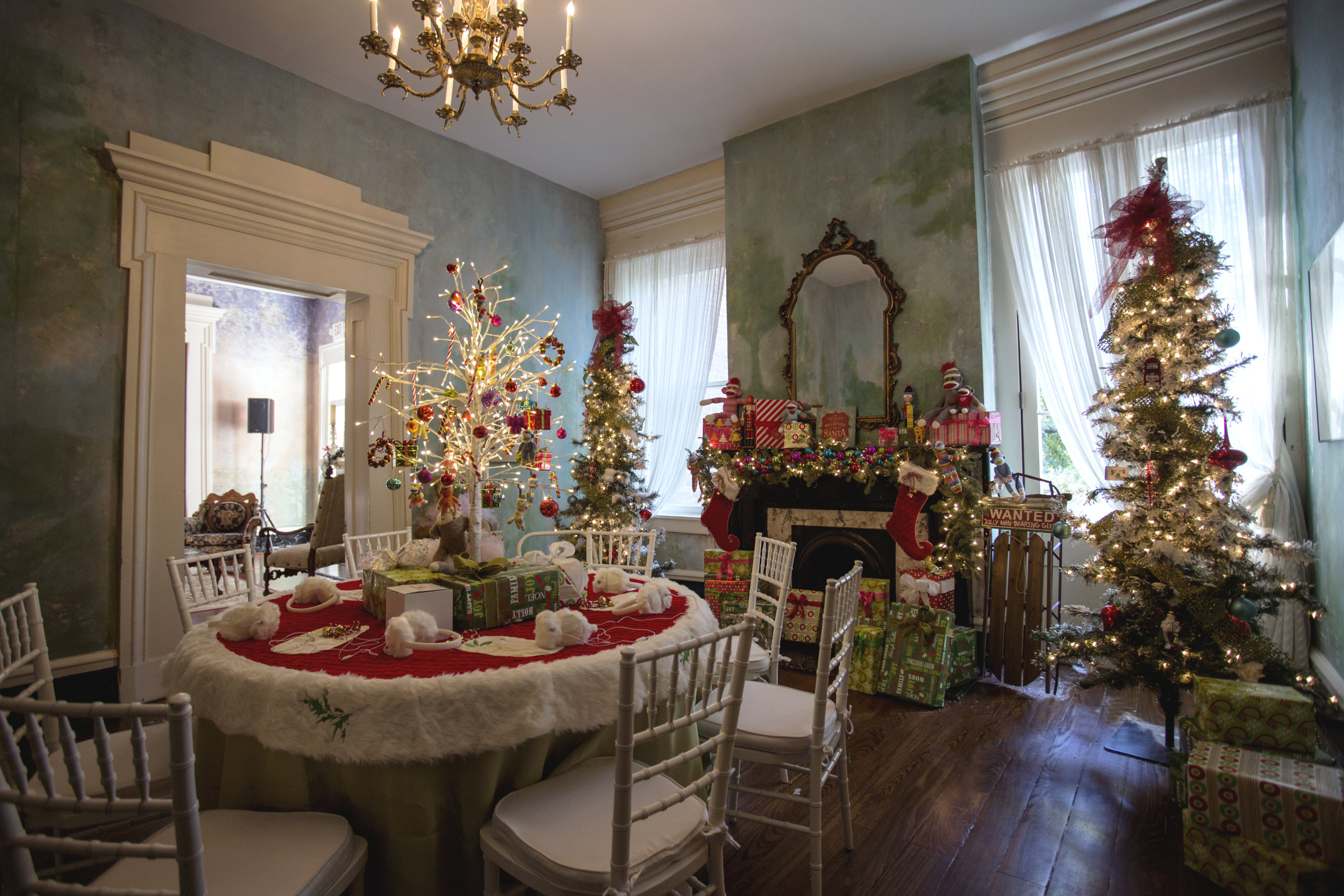 """Downstairs, party guests were able to listen to Musgraves'upcoming Christmas album, """"A Very Kacey Christmas"""" at a table set up with seven white fluffy earmuff headphones.  Photo:  Angelea  Decor: Balsam Hill"""