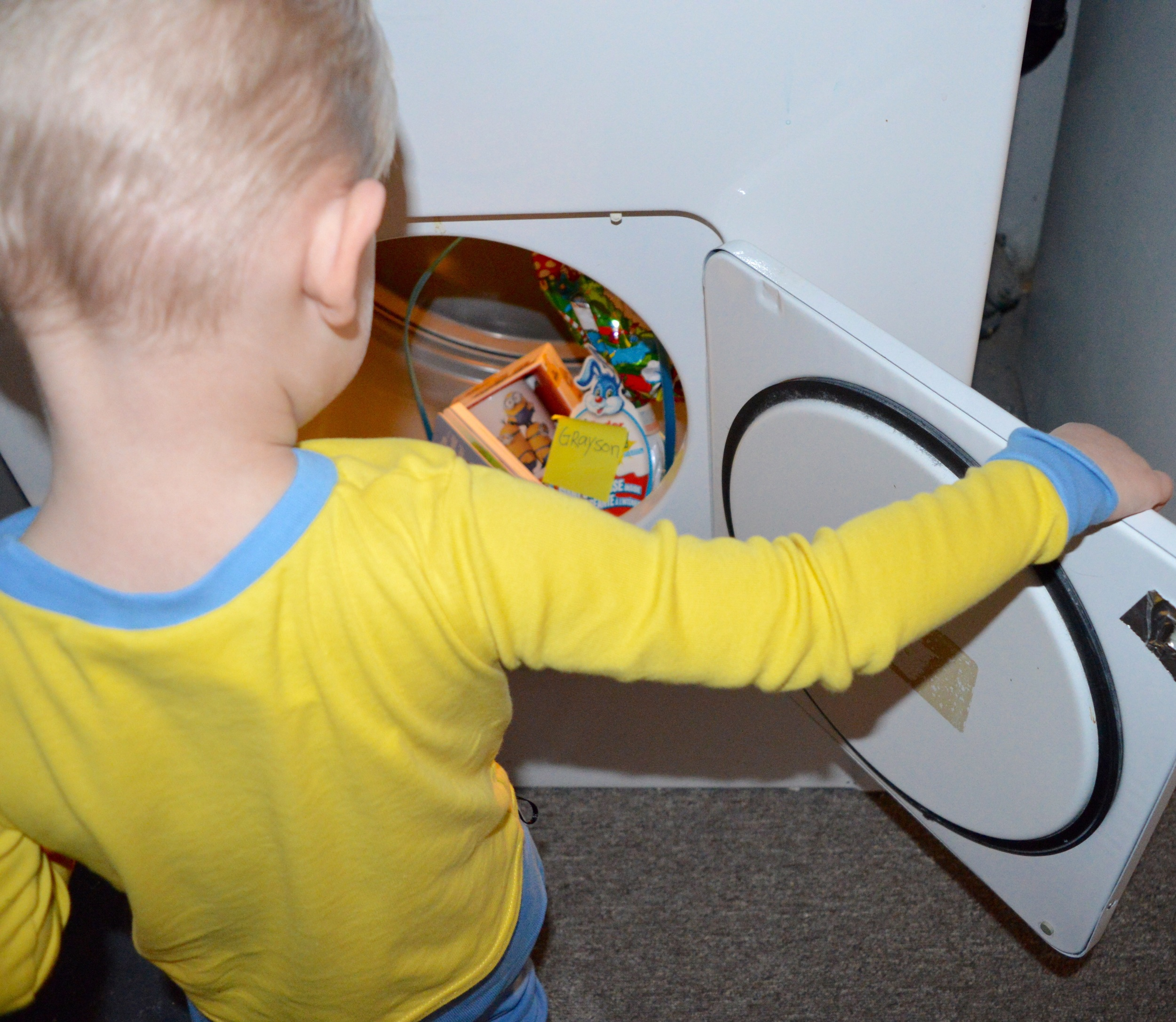 Finding his basket in the dryer! He was so happy! He got his own minions cup for hot chocolate a new book and his favourite things right now in the large size- kinder egg surprise!!