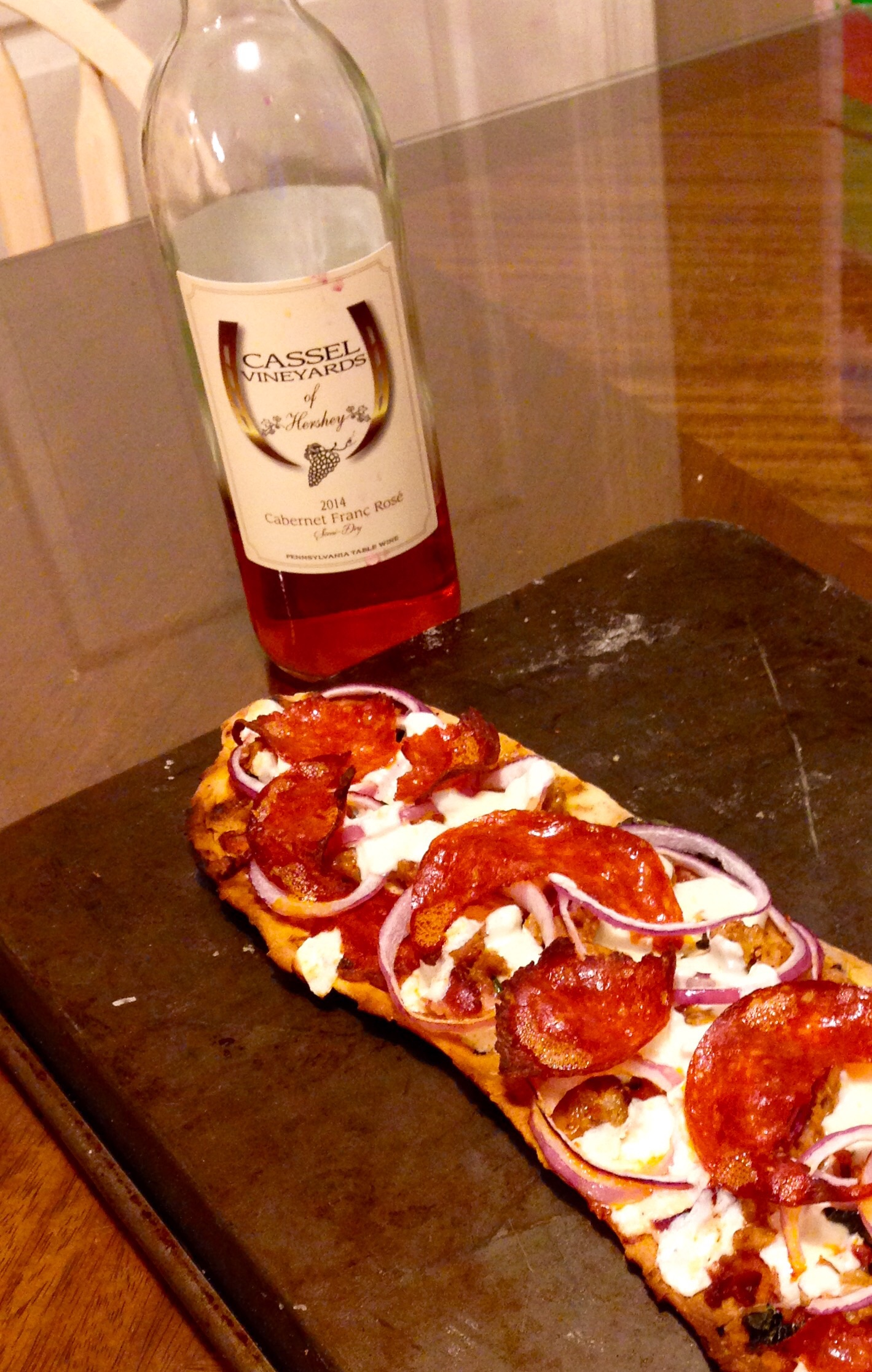 Kim and Adams grilled pizza pairs perfectly with our Cab Franc Rose'