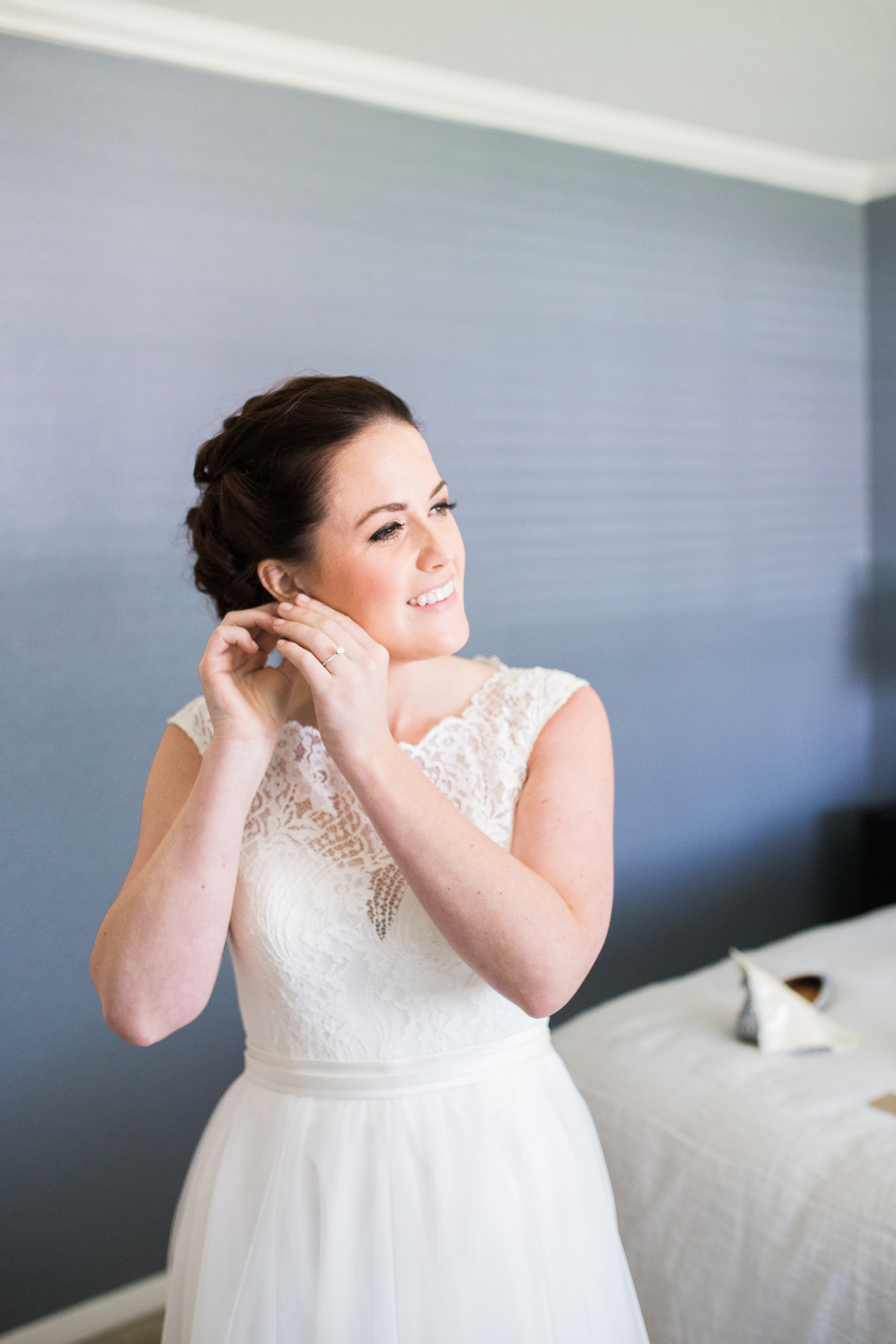 Coohills Wedding Photographer - bride putting on earrings