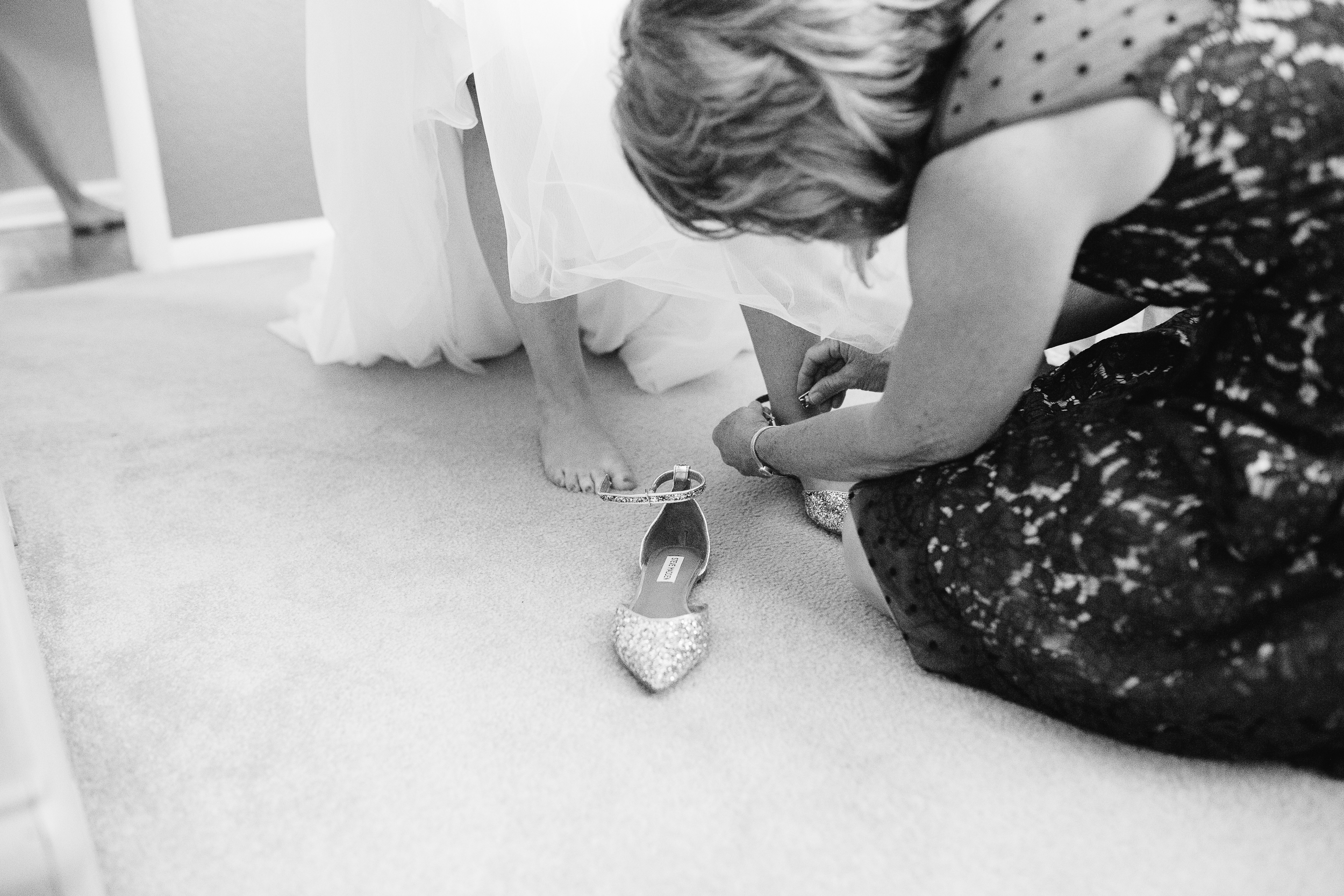 Coohills Wedding Photographer - putting on wedding flats