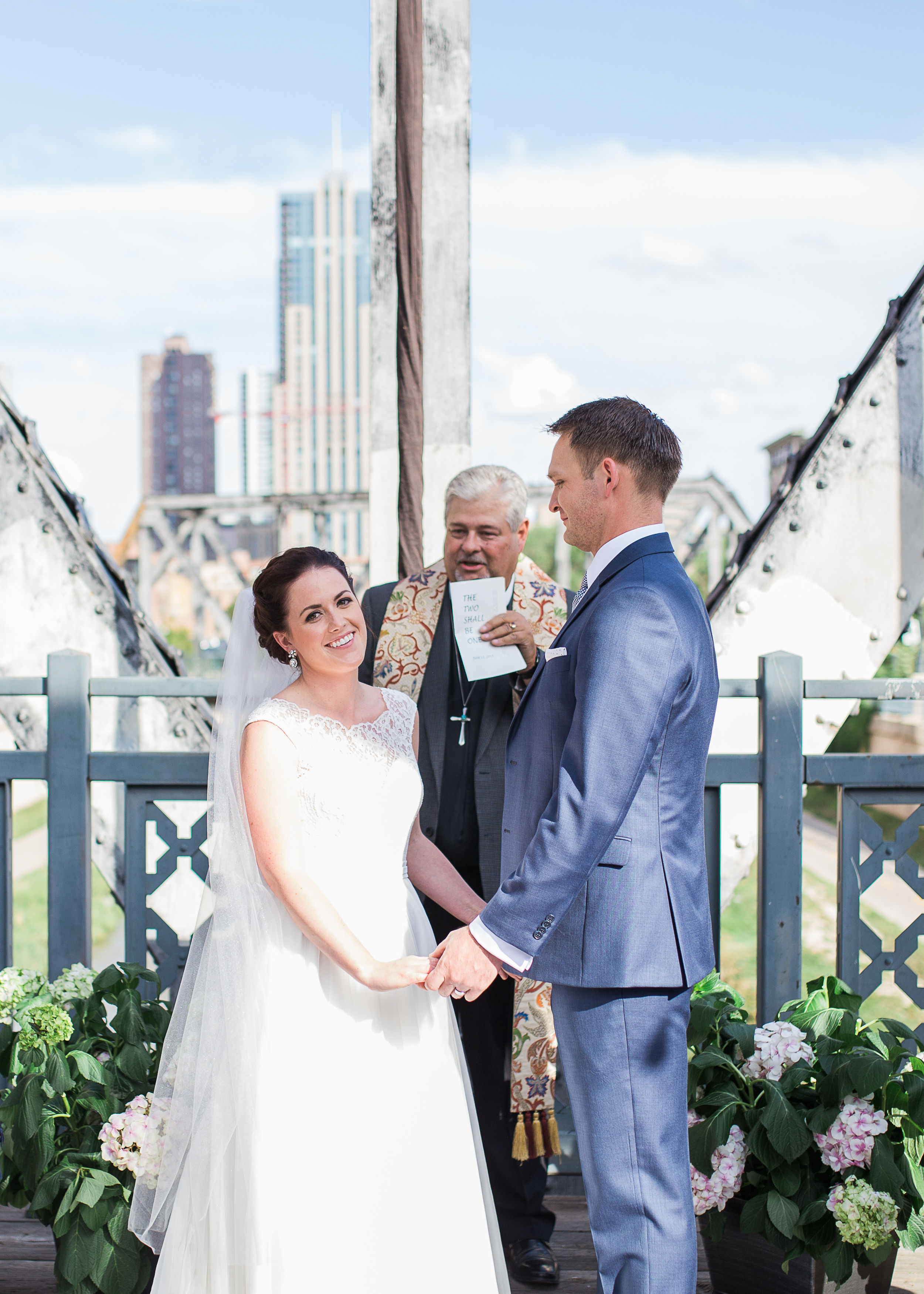Coohills Wedding Photographer - bride and groom during ceremony on bridge