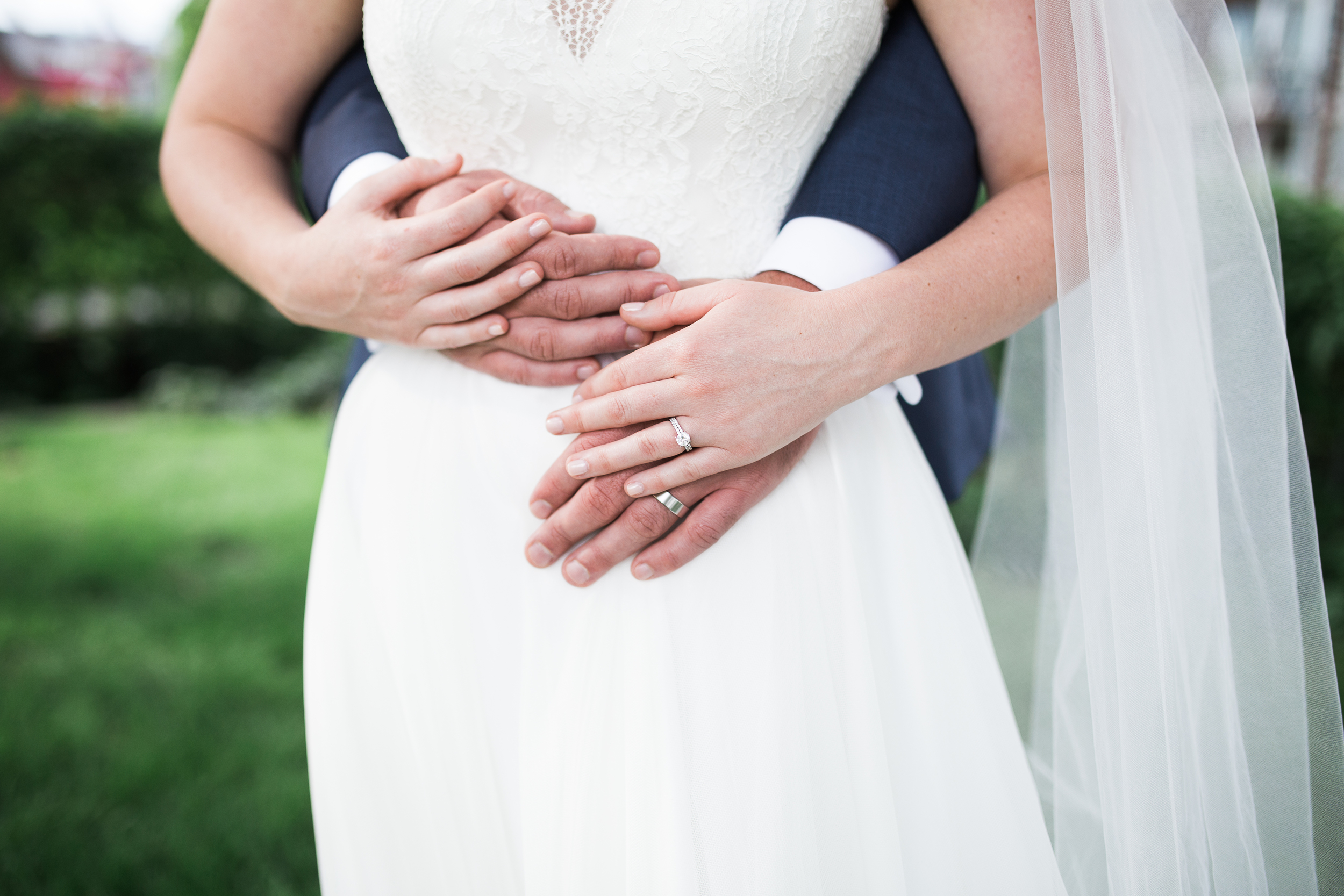 Coohills Wedding Photographer - bride and groom hugging with rings