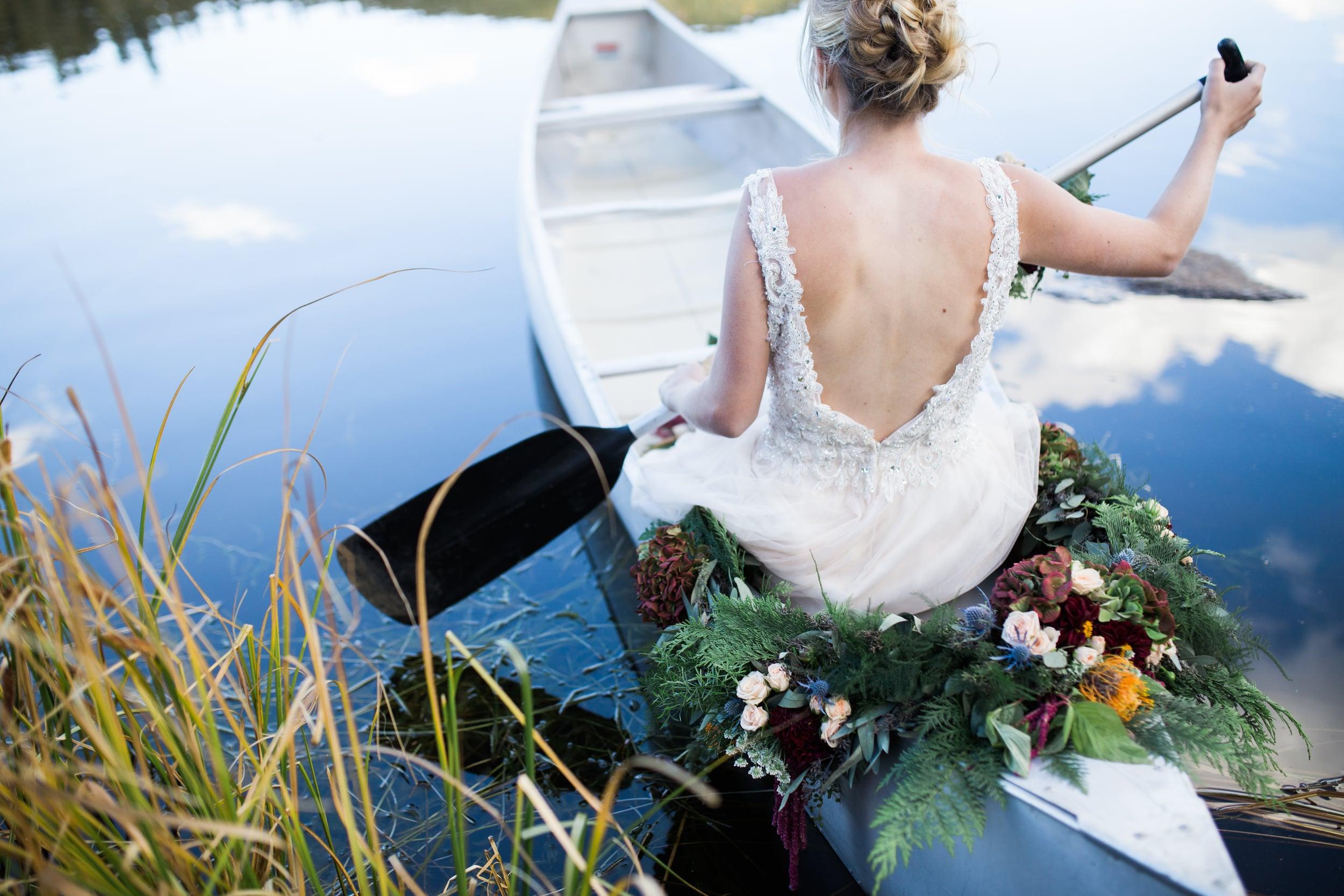Colorado Mountain Wedding Photographer - bride on canoe