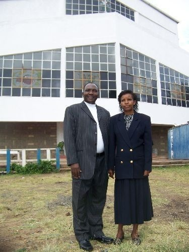 Steve and Jennifer Kabachia stand before the home church in Madaraka neighborhood in Nairobi, Kenya