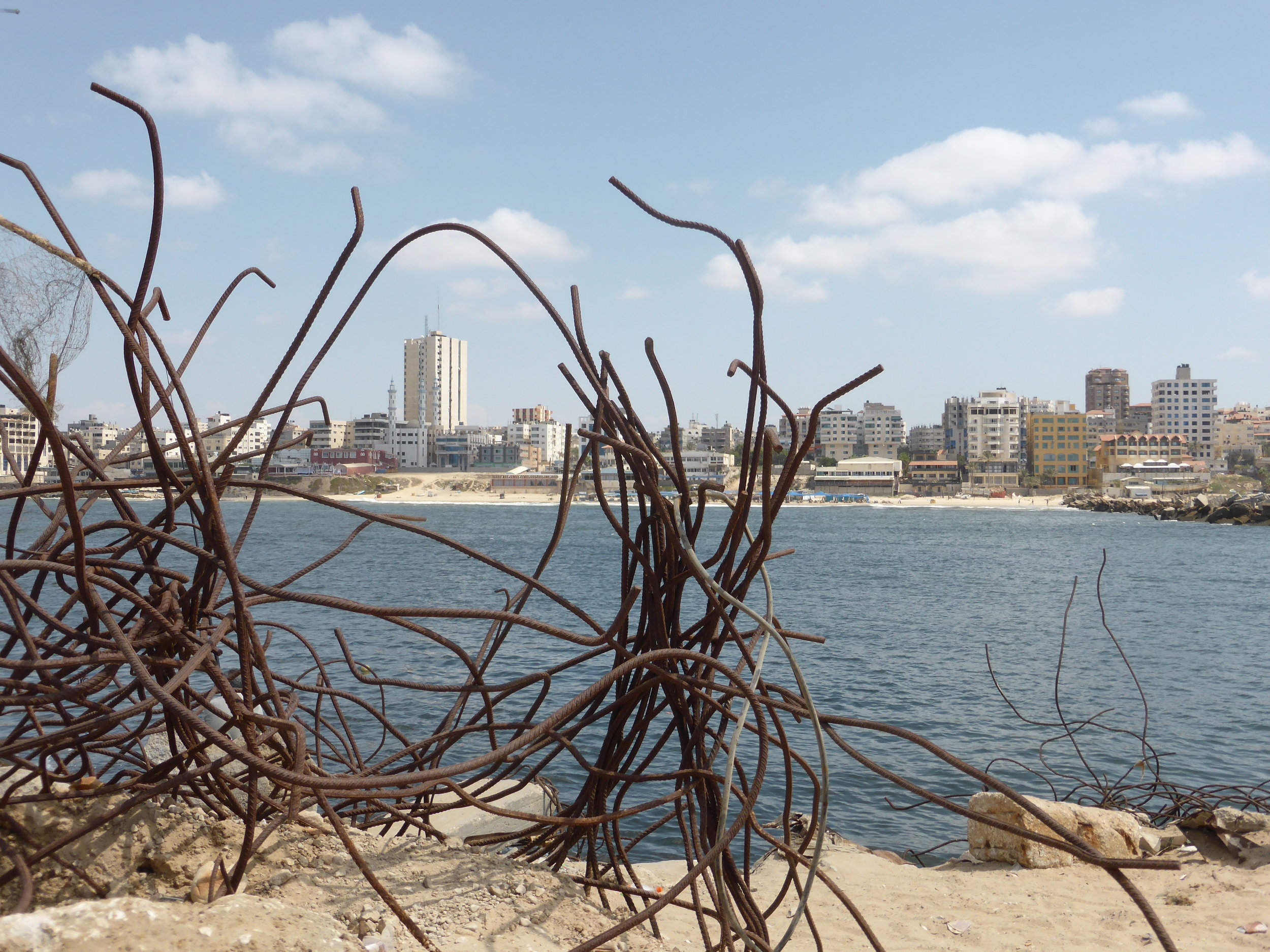 Standing on the breakwater, and looking back towards Gaza City and the shoreline.