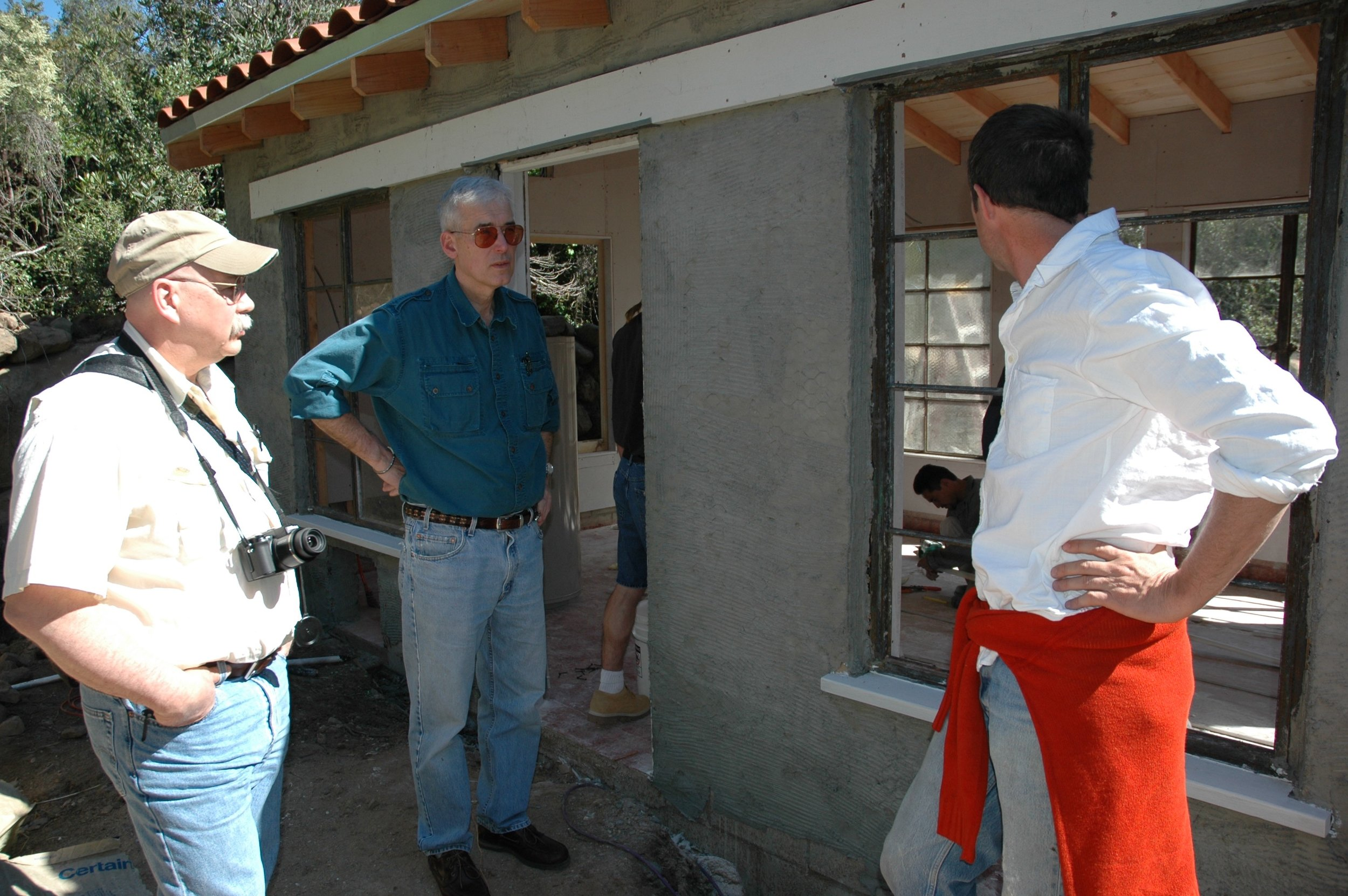 John Behler (center) inspects the animals' new home in California, constructed by Turtle Conservancy founder Eric Goode (right).