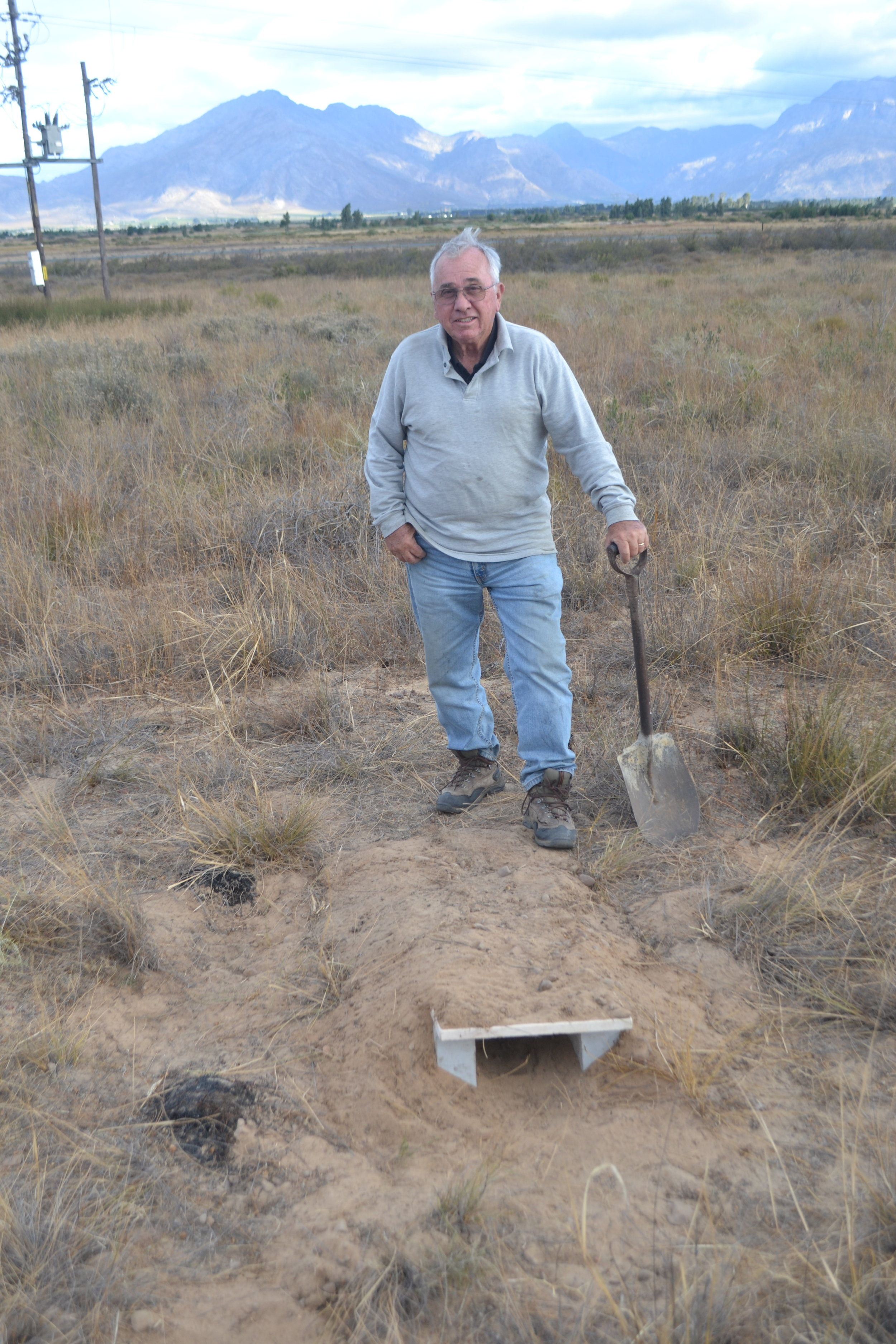"Turtle Conservancy Senior Conservation Scientist Jim Juvik building ""fire bunker"" tortoise retreats on reserve. Larger burrowing animals (Aardvarks) that might have provided these retreats in the past are no longer present in the reserve."