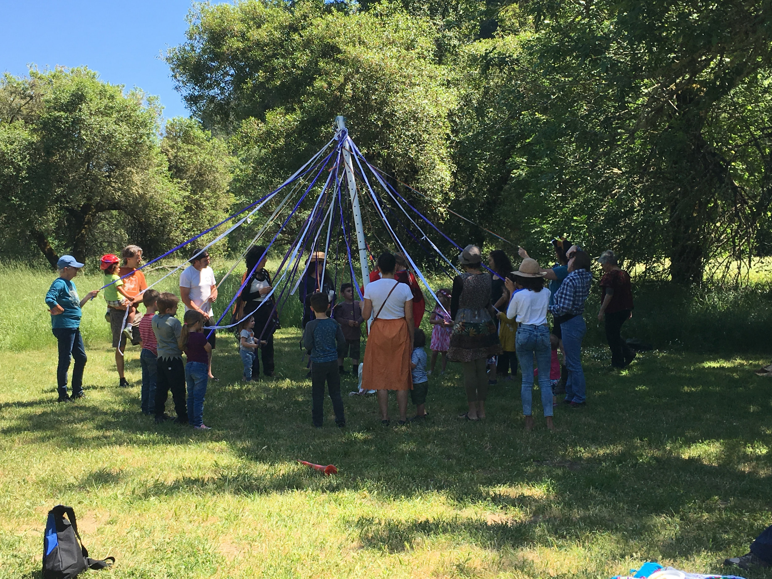 Preparing to dance around the Maypole and weave the strands together