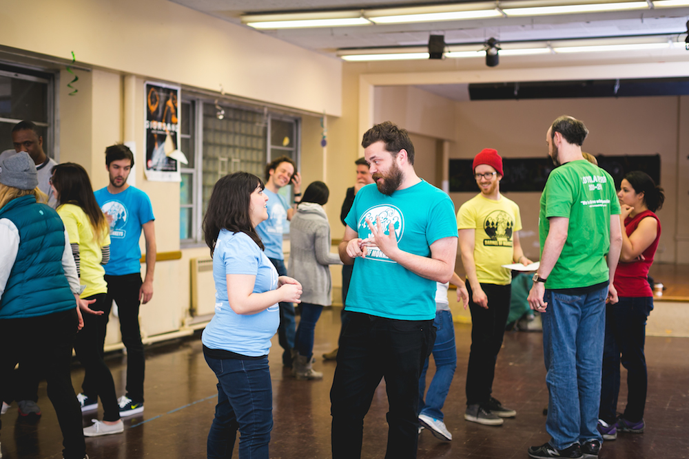 Levy, Schupbach, and other BOM members workshopping student plays