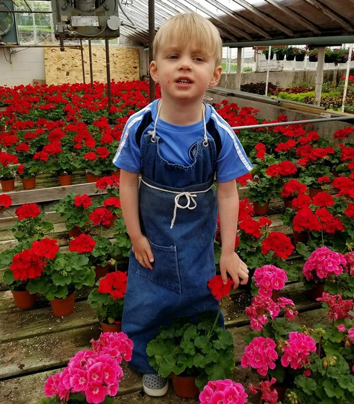 Evan's 3rd year as manager at Omaha's Florist supervising the beautiful flowers in the greenhouse.
