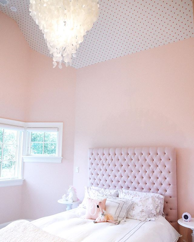 Pink polka dot wallpaper on the ceiling adds a playful addition to a child's bedroom when carefully selected and styled with sophisticated and tasteful furnishings and accessories.