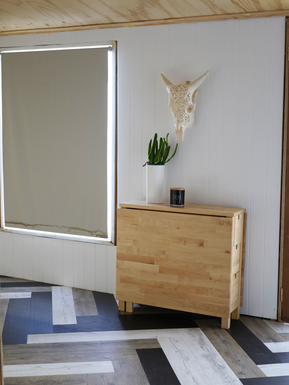 DIY vinyl plank herringbone floor