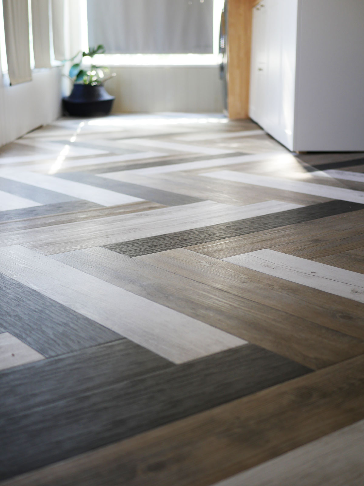 Stick down herringbone floor