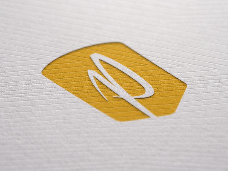 Secondary badge mark, letterpressed.