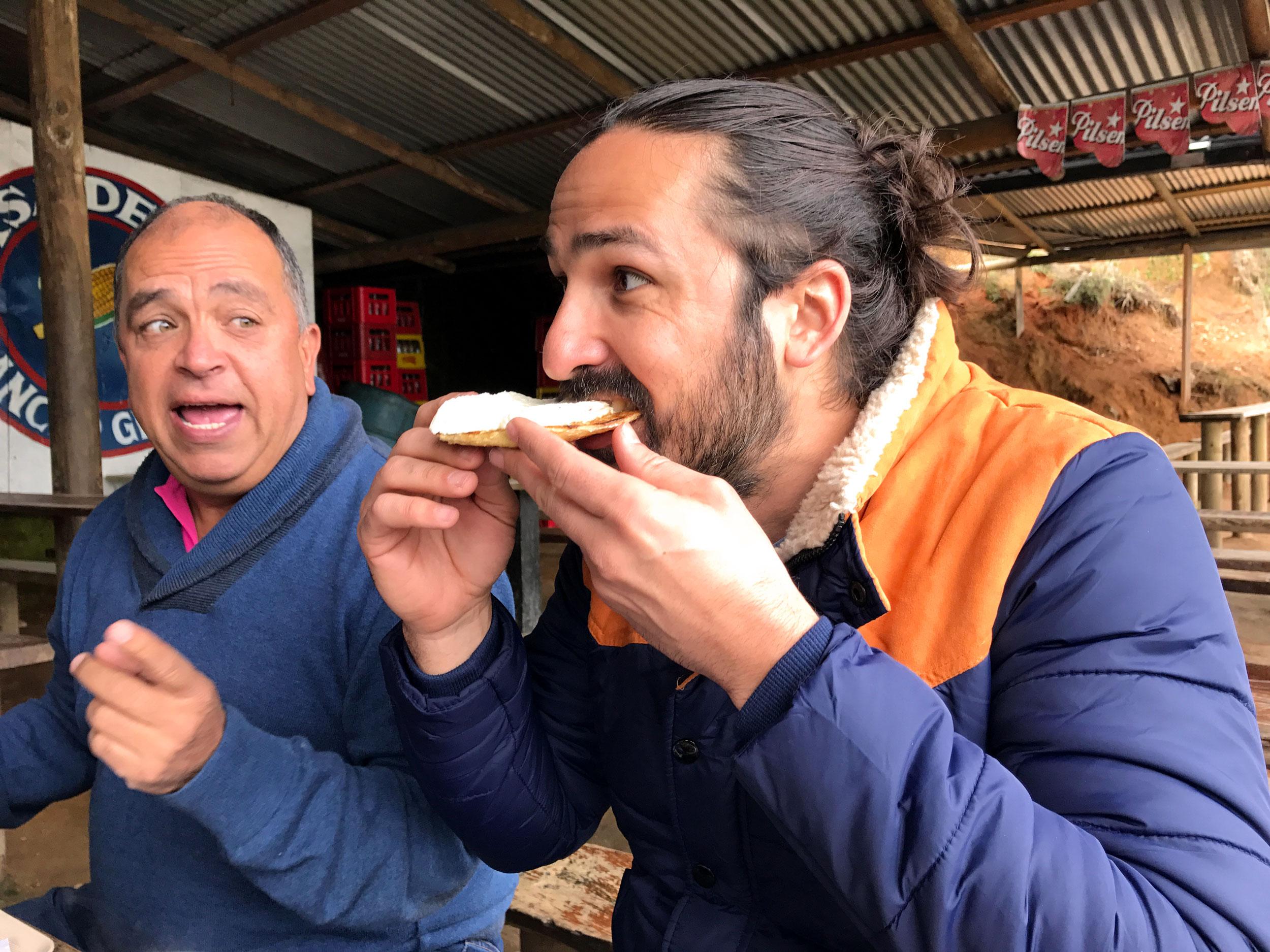 Diego and Juan eating arepas
