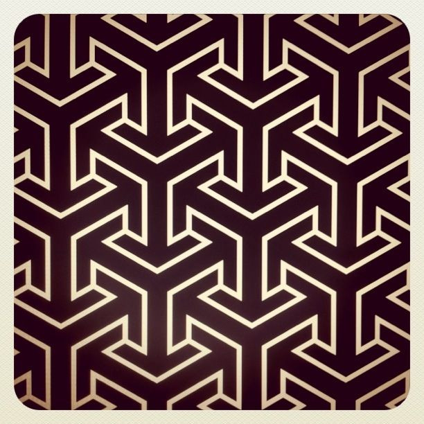 A pattern loosely based off the wallpaper of the swanky sub in X-Men: First Class. I'm in love with tesselation and the secret lives of hexagons.