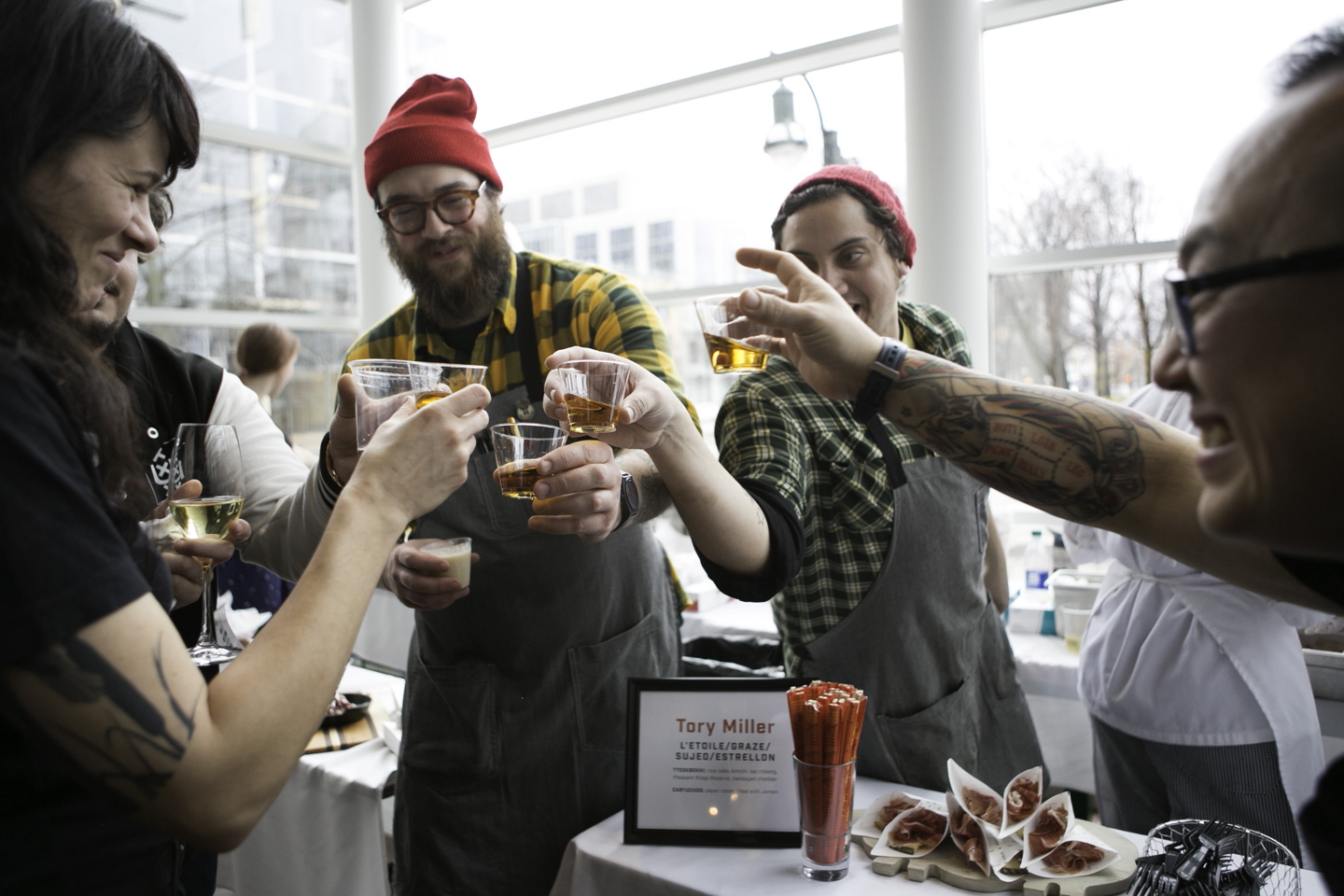Local celebrity chef, Tory Miller, toasts to Chef Week with his employees. Miller was recently nominated for what would be his second James Beard Award.